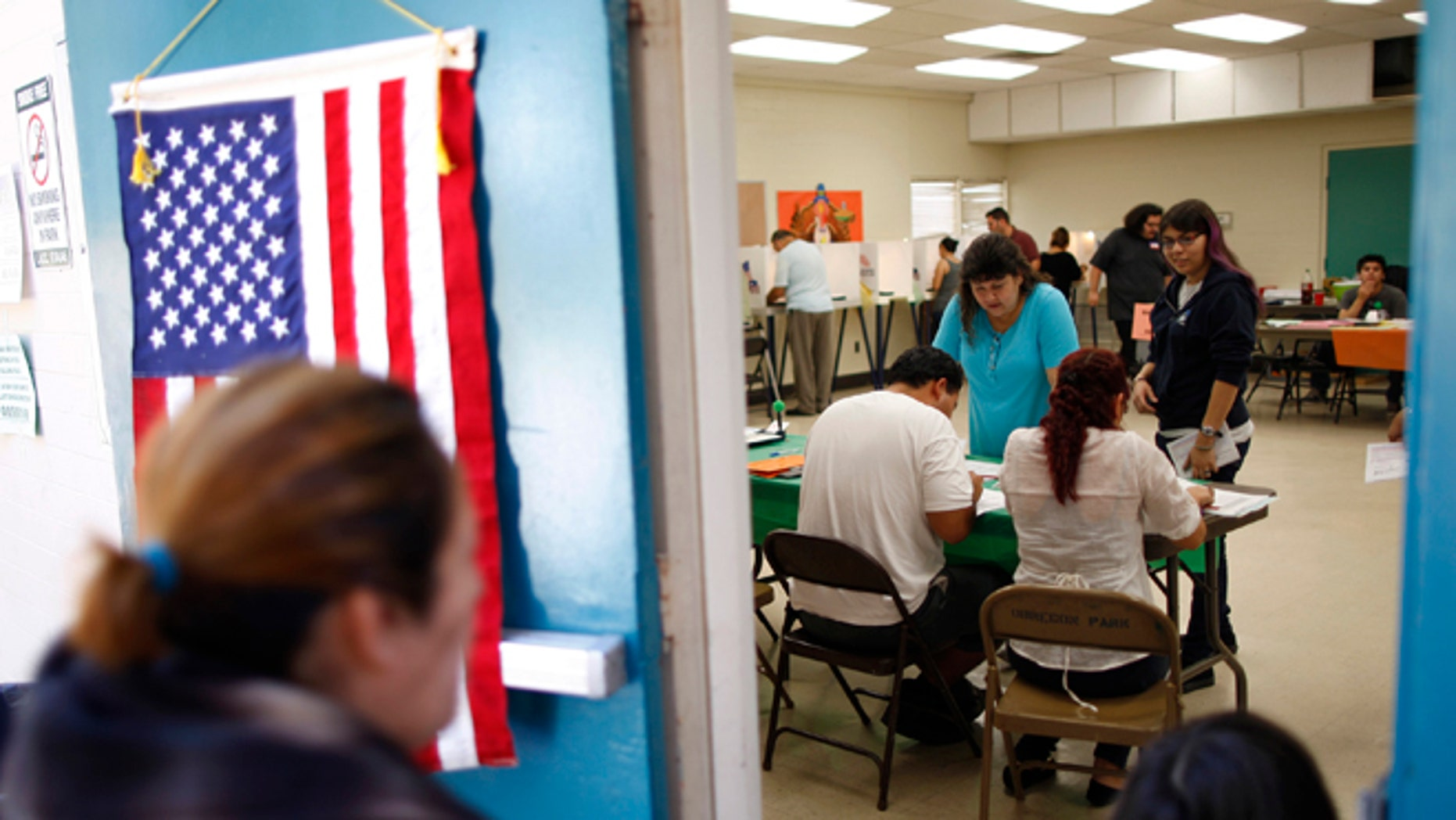 People vote at a polling place in the heavily Latino East L.A. area during the U.S. presidential election on November 6, 2012 in Los Angeles, California.   (Photo by David McNew/Getty Images)