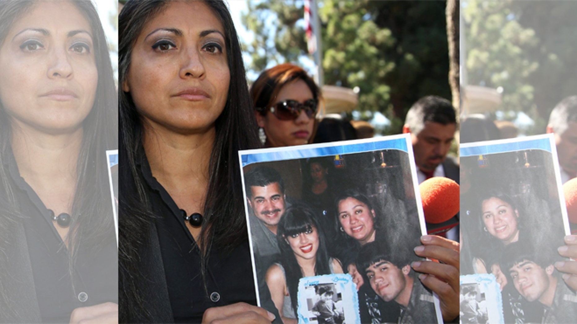 FILE - In this Oct. 2, 2014 file photo, attorney Claudia Osuna holds a photo of the Crespo family - from top left to bottom right, Bell Gardens, Calif., Mayor Daniel Crespo, his daughter Crystal, his wife Lyvette and son Daniel Crespo Jr., during a news conference in the Los Angeles surbuban city of Bell Gardens. A Los Angeles County grand jury has indicted Lyvette Crespo on a charge of voluntary manslaughter the shooting death of Daniel Crespo. The district attorneyâs office says Lyvette Crespo pleaded not guilty Thursday, April 23, 2015, during an arraignment at which the indictment was unsealed. The 45 year-old mayor was fatally shot at his home on Sept. 30, 2014. (AP Photo/Nick Ut, File)