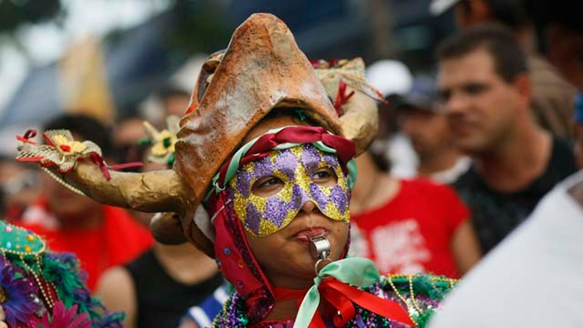 March 16, 2008:  Revelers enjoy themselves as they walk along the street during the annual Calle Ocho celebration in the Little Havana neighborhood of Miami, Fla. The event is billed as the largest Hispanic festival in the nation.