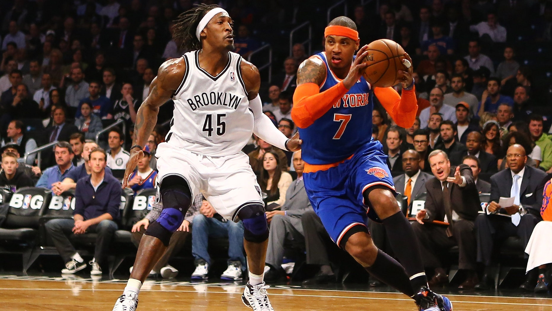 Carmelo Anthony #7 of the New York Knicks drives against Gerald Wallace #45 of the Brooklyn Nets  during their game at the Barclays Center on December 11, 2012 in the Brooklyn borough of New York City. (Photo by Al Bello/Getty Images)