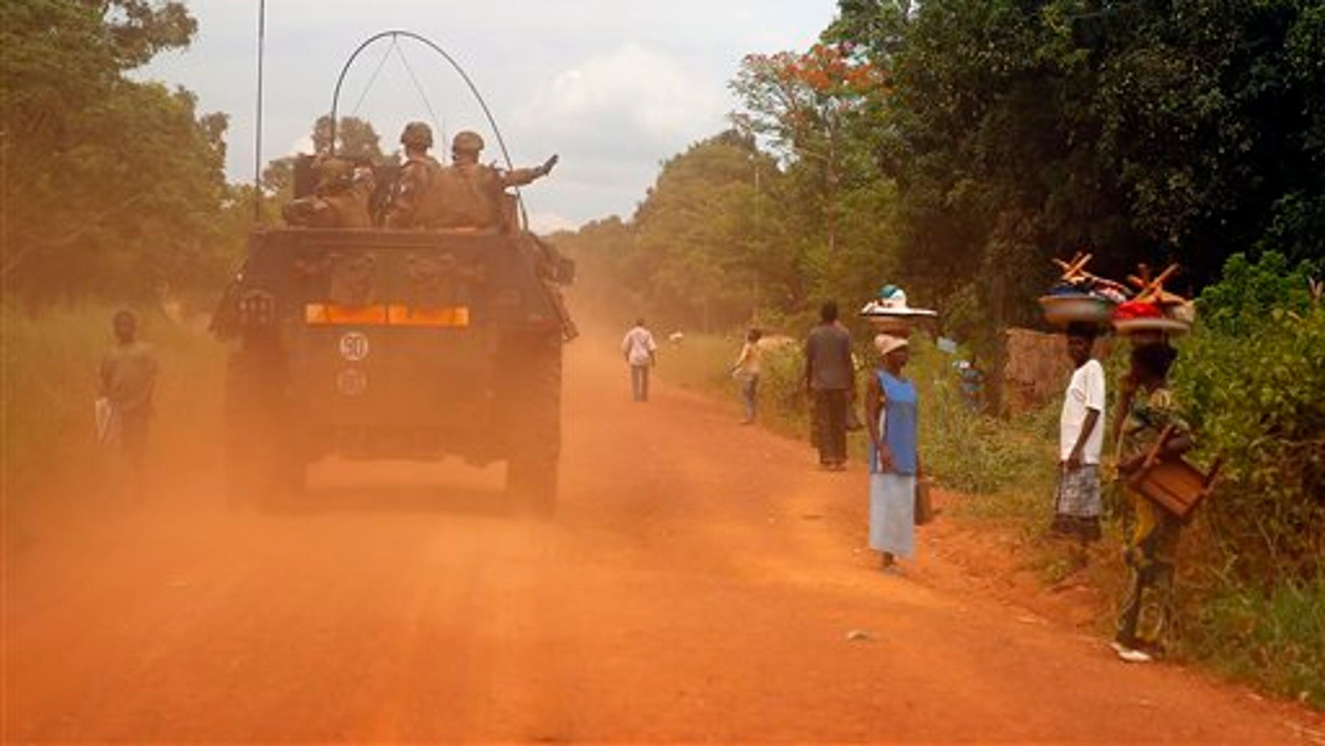 FILE - This April 11, 2014, image shows French forces patrolling in Sibut, some 140 miles northeast of Bangui, Central African Republic. French prosecutors and military authorities are investigating accusations that French soldiers in Central African Republic sexually abused children they were sent to protect. (AP Photo/Jerome Delay, File)