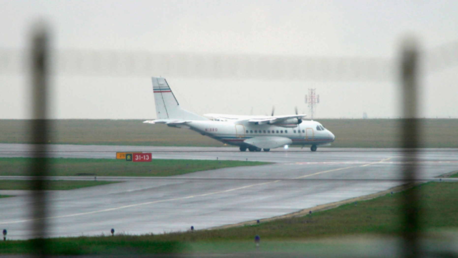 PRAGUE, CZECH REPUBLIC - APRIL 8: (FILE PHOTO) A Casa 235 turboprop plane with registration number N168D taxis along a runway at Ruzyne Airport April 8, 2005 in Prague, Czech Republic. According to airport flight records the plane was registered to the firm Aero Contractors, based in North Carolina, and was scheduled to fly from Prague to Kabul, Afghanistan. In May, 2005 the New York Times reported that Aero Contractors was involved in transporting terrorism suspects to third countries. And on November 17, 2005, Agence France Presse reported that a plane with registration number N168D and owned by Devon Holding and Leasing passed through Danish airspace on October 3, 2005 en route from Iceland to Budapest. Countries across Europe are investigating reports that airplanes flying for the CIA landed at their airports or passed through their airspace without their permission.      (Photo by Pavel Horejsi/Getty Images)