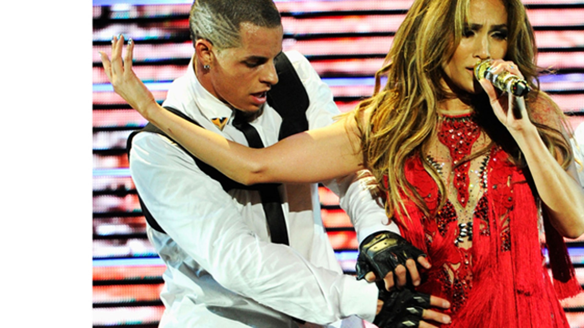 Sept. 24, 2011: Singer Jennifer Lopez and dancer Casper Smart perform onstage at the iHeartRadio Music Festival held at the MGM Grand Garden Arena in Las Vegas, Nev.