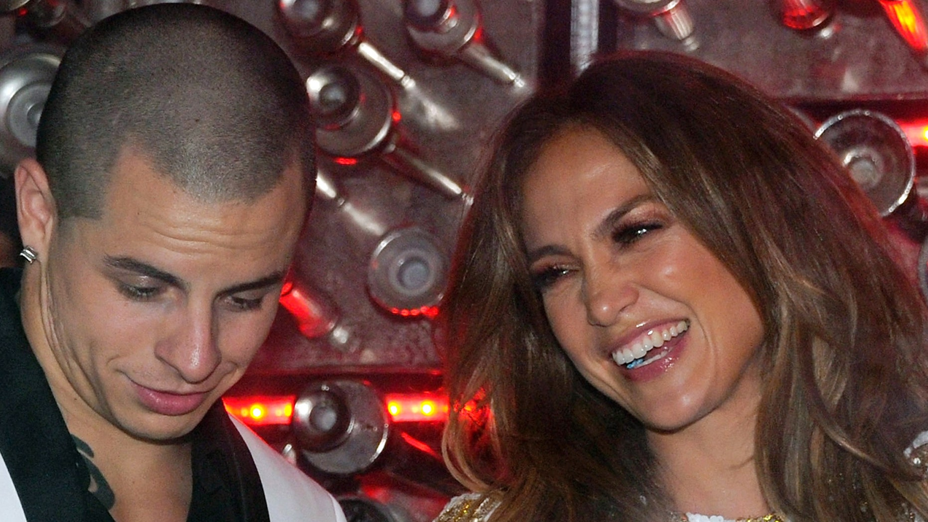 """LAS VEGAS, NV - MAY 27:  Dancer Casper Smart (L) and singer/actress Jennifer Lopez share a laugh as they celebrate the launch of Lopez's new single, """"Goin' In"""" at Hyde Bellagio at the Bellagio May 27, 2012 in Las Vegas, Nevada.  (Photo by Ethan Miller/Getty Images for Hyde Bellagio)"""