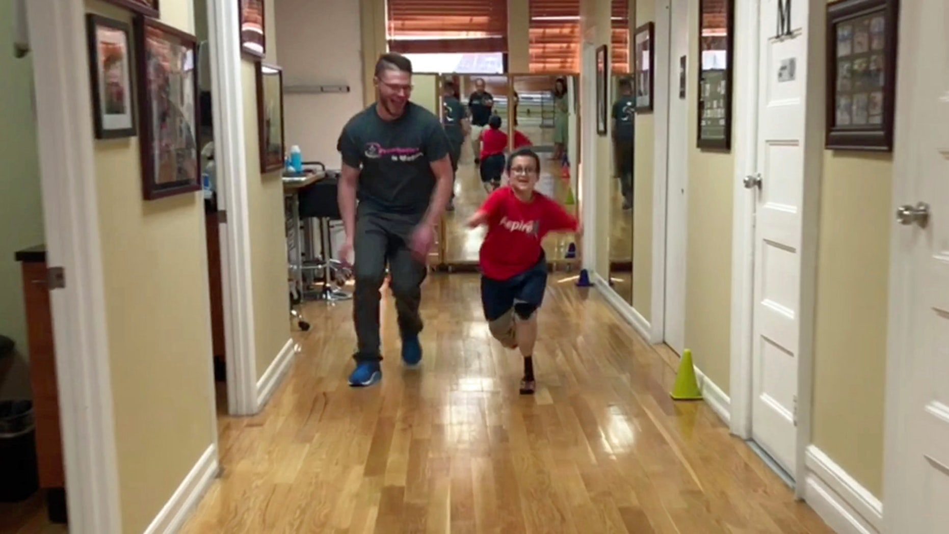 Quad amputee Moshe runs for the very first time, thanks to state-of-the-art prosthetics).