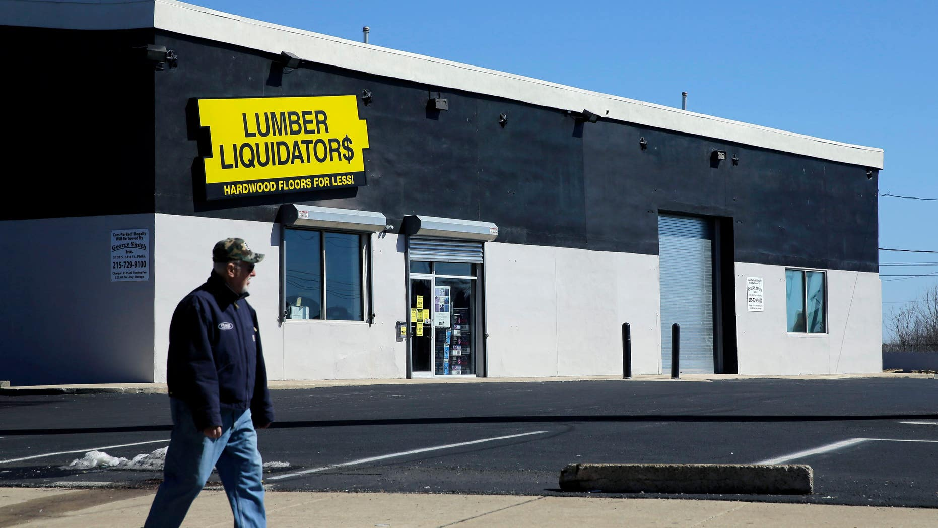 In this March 12, 2015, file photo, a man walks past a Lumber Liquidators store in Philadelphia.