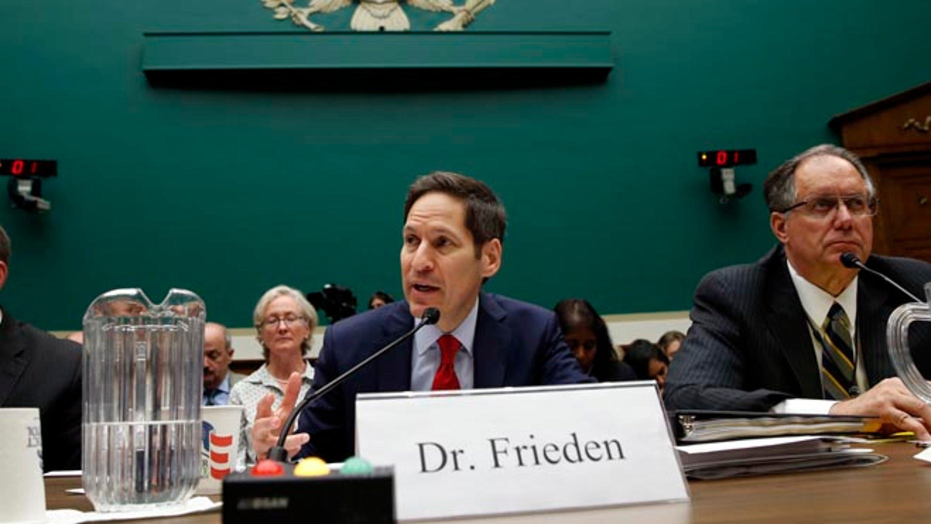 """U.S. Centers for Disease Control and Prevention (CDC) Director Tom Frieden testifies at a House Energy and Commerce Subcommittee on Oversight and Investigations hearing called the """"Review of CDC Anthrax Lab Incident"""" on Capitol Hill in Washington July 16, 2014. Flanking Frieden are Joseph Henderson (L), deputy director of the CDC's Office of Security and Emergency Preparedness, and Jere Dick, associate deputy administrator of the Animal and Plant Health Inspection Services at the U.S. Department of Agriculture."""