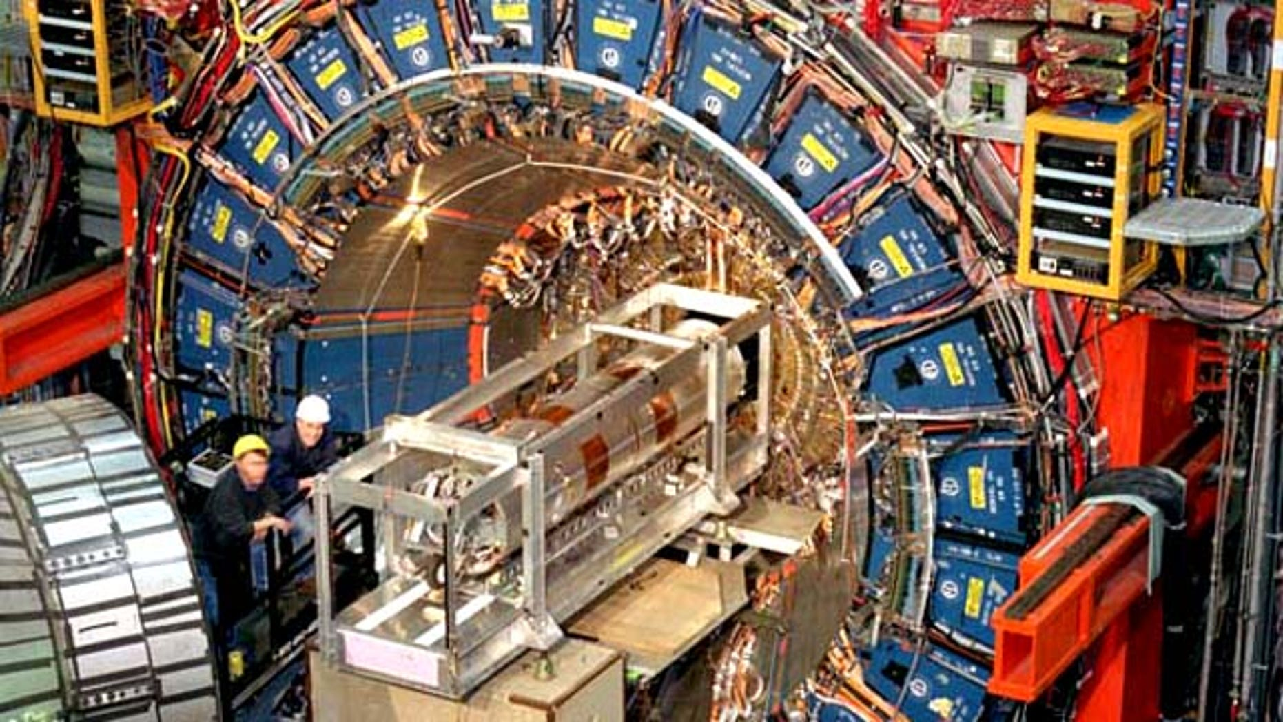 """The CDF detector at U.S. science facility Fermilab. About the size of a three-story house, and weighing about 6,000 tons, it records the """"debris"""" emerging from each high-energy proton-antiproton collision produced by the Tevatron particle colider."""