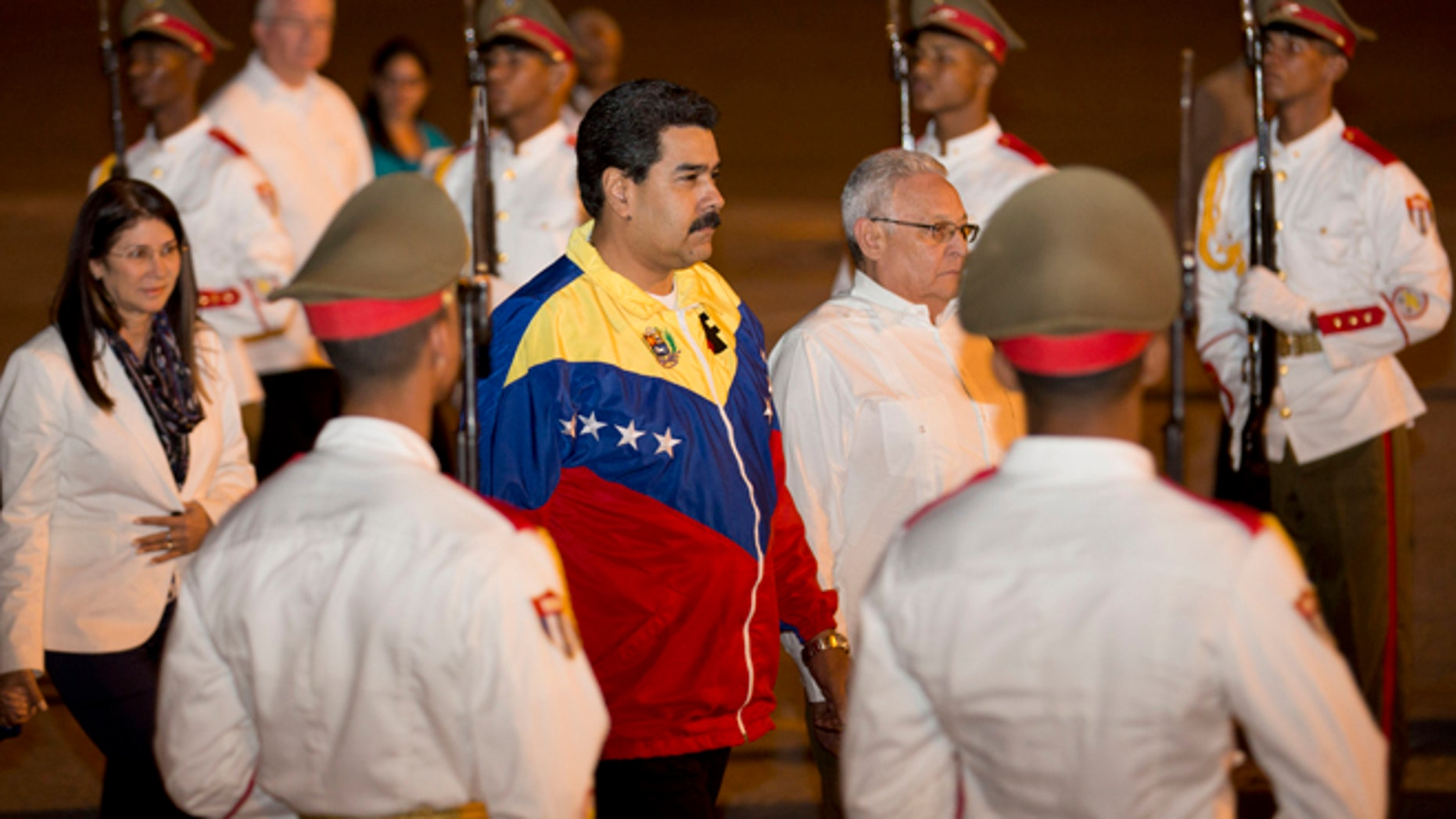 Venezuela's President Nicolas Maduro, center, arrives at the Jose Marti International airport in Havana, Cuba, Sunday, Jan. 26, 2014. Leaders from Latin America and the Caribbean are arriving in Havana this week to participate in the Community of Latin American and Caribbean States, or CELAC summit. Lower-level officials began meeting over the weekend and foreign ministers are taking the stage Monday. The formal meetings of heads of state begin Tuesday. (AP Photo/Ramon Espinosa)