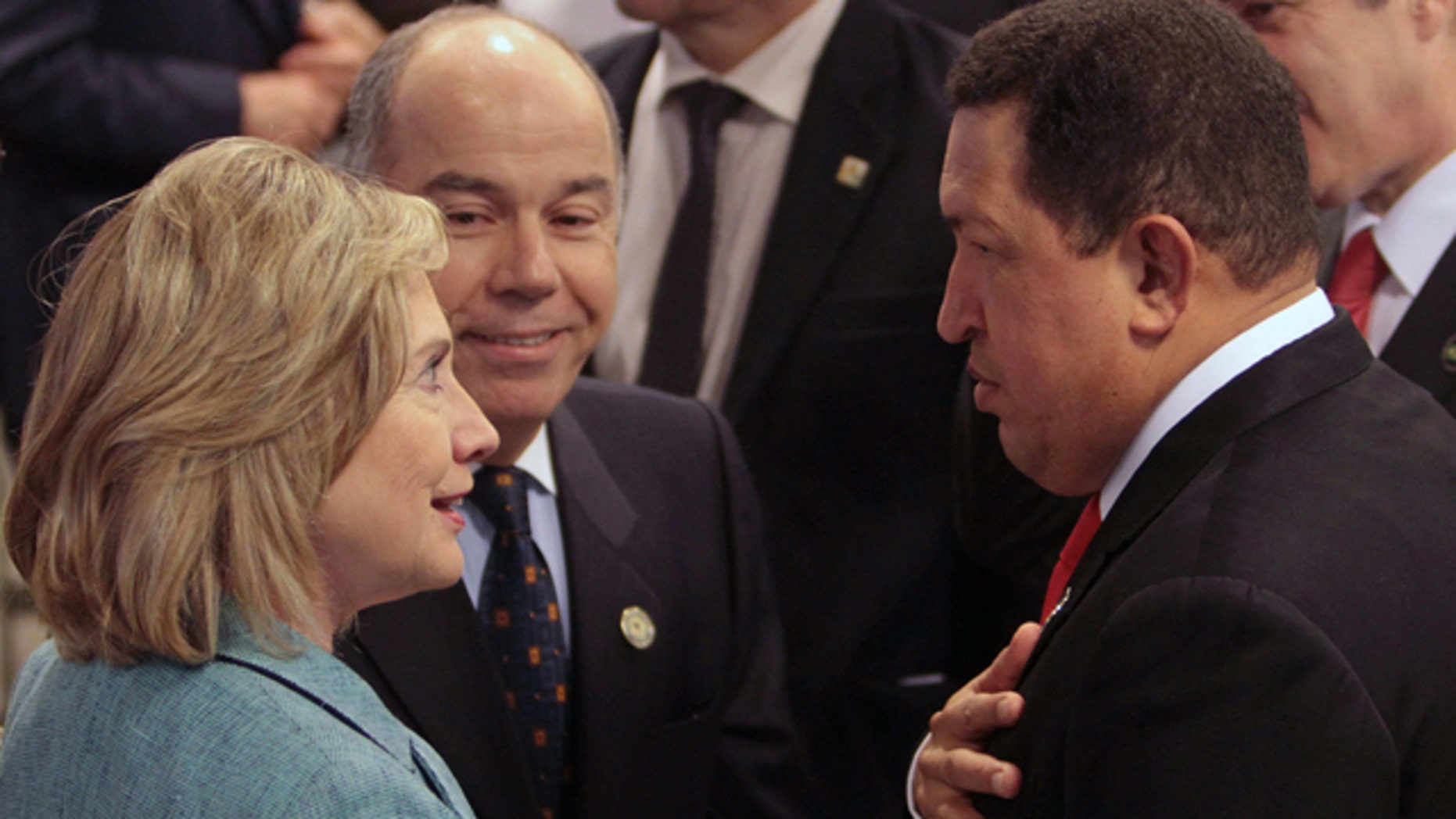 Jan. 1, 2011: U.S. Secretary of State Hillary Clinton speaks with Venezuela's President Hugo Chavez during the swearing-in ceremony of Brazil's President Dilma Rousseff