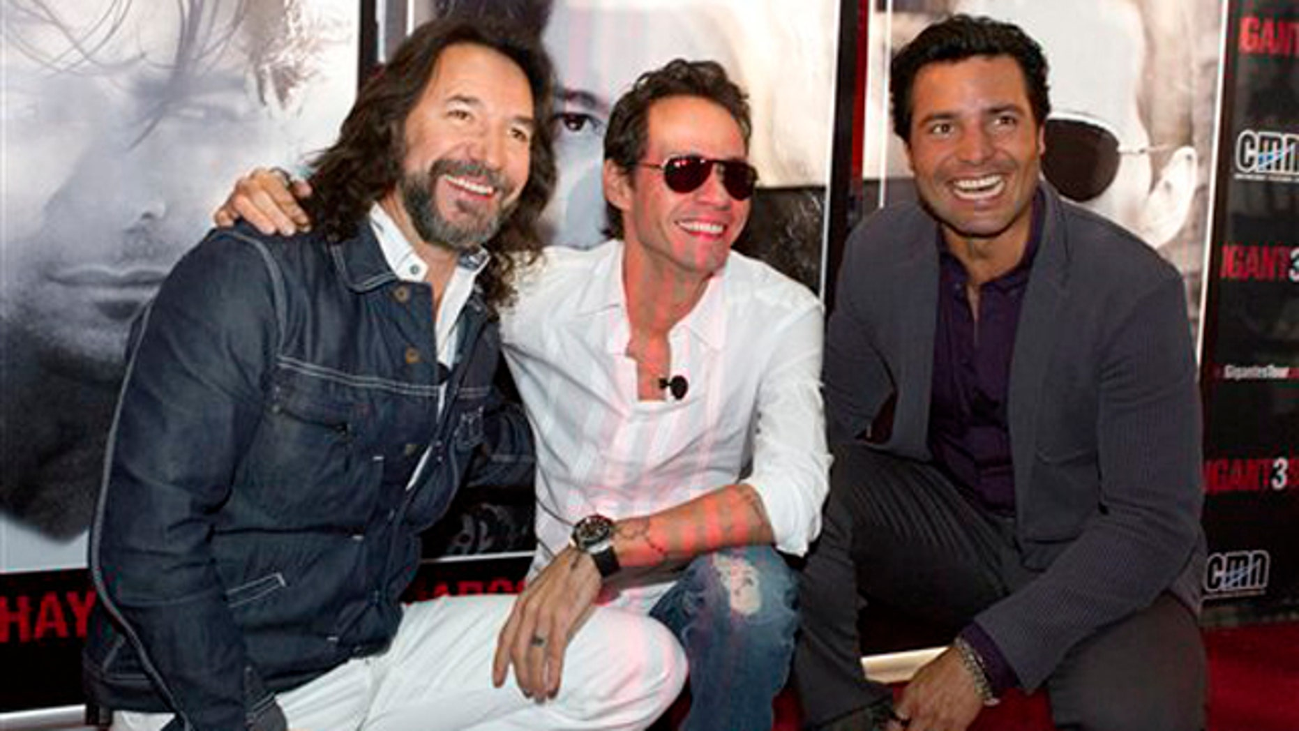 "April 23, 2012: Marco Antonio Solis, left, Marc Anthony, center, and Chayanne, pose at the American Airlines Arena in Miami, Fla., to announce their National tour concert called ""GIGANT3S."" The tour will kick-off in Miami on Aug. 3."
