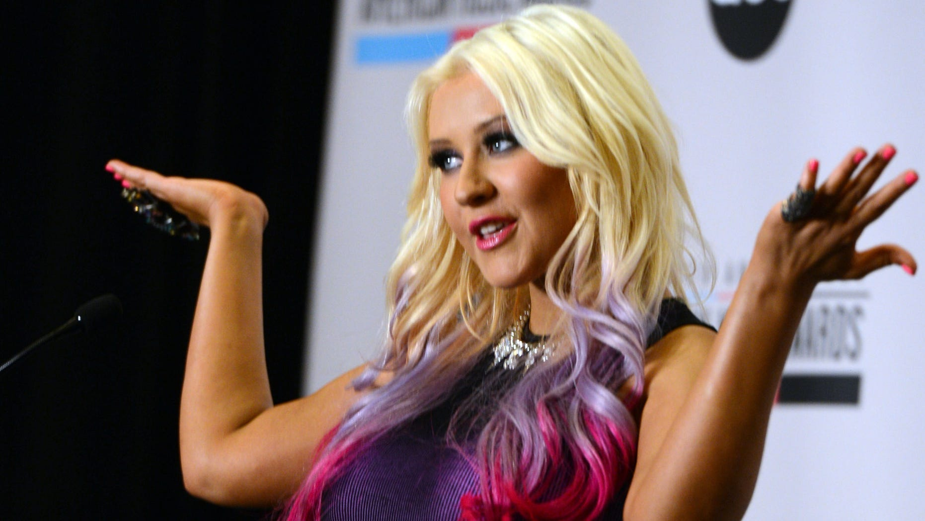 LOS ANGELES, CA - OCTOBER 09:  Singer Christina Aguilera speaks onstage during the 40th Anniversary American Music Awards nominations press conference at the JW Marriott Los Angeles at L.A. LIVE on October 9, 2012 in Los Angeles, California.  (Photo by Kevin Winter/Getty Images)