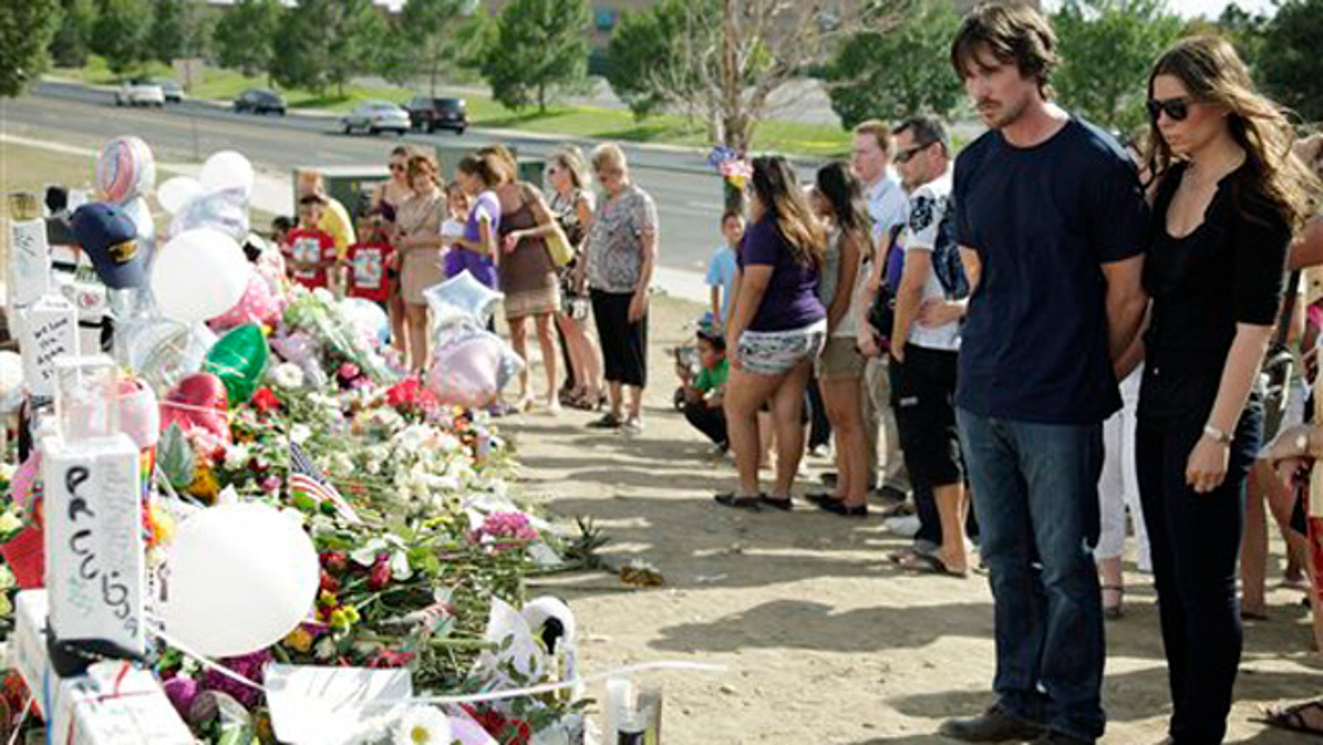 July 24, 2012: Actor Christian Bale and his wife Sibi Blazic visit a memorial to the victims of Friday's mass shooting in Aurora, Colo.