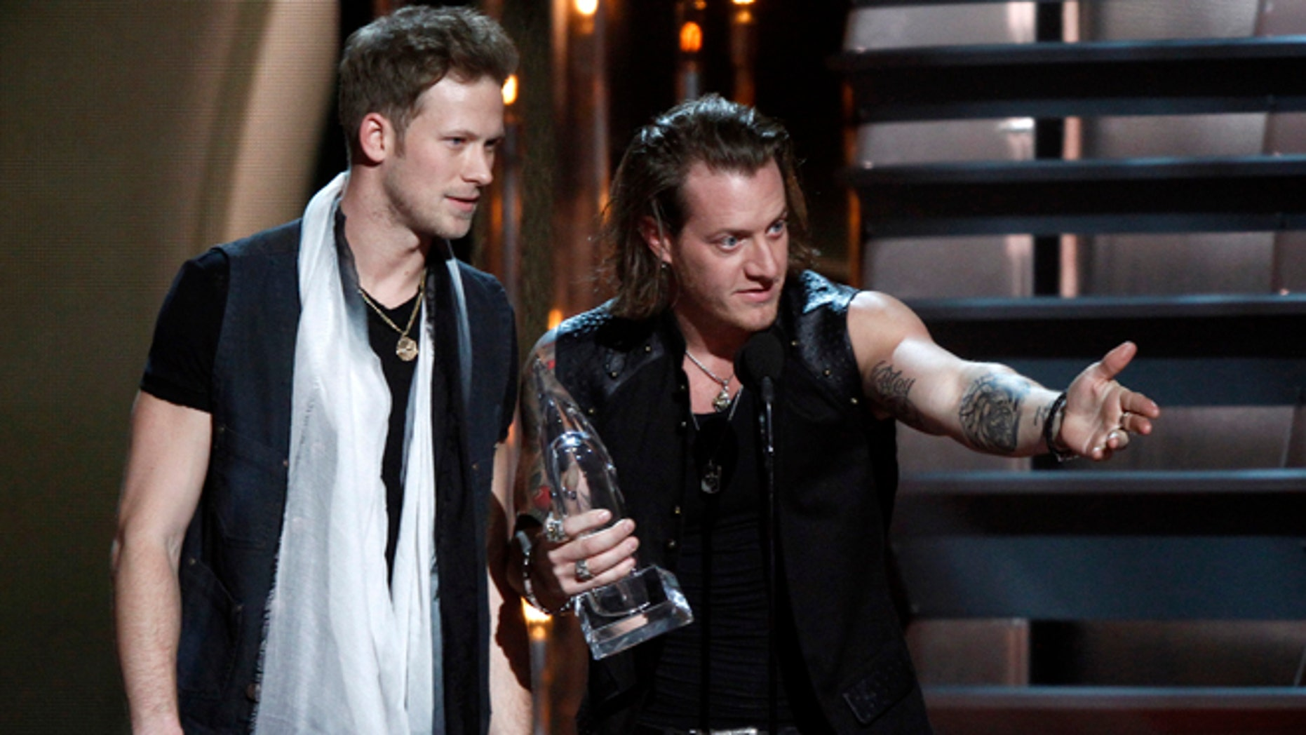 Nov. 6, 2013: Brian Kelley, left, and Tyler Hubbard, of Florida Georgia Line, accept the award for vocal duo of the year at the 47th annual CMA Awards at Bridgestone Arena in Nashville, Tenn.