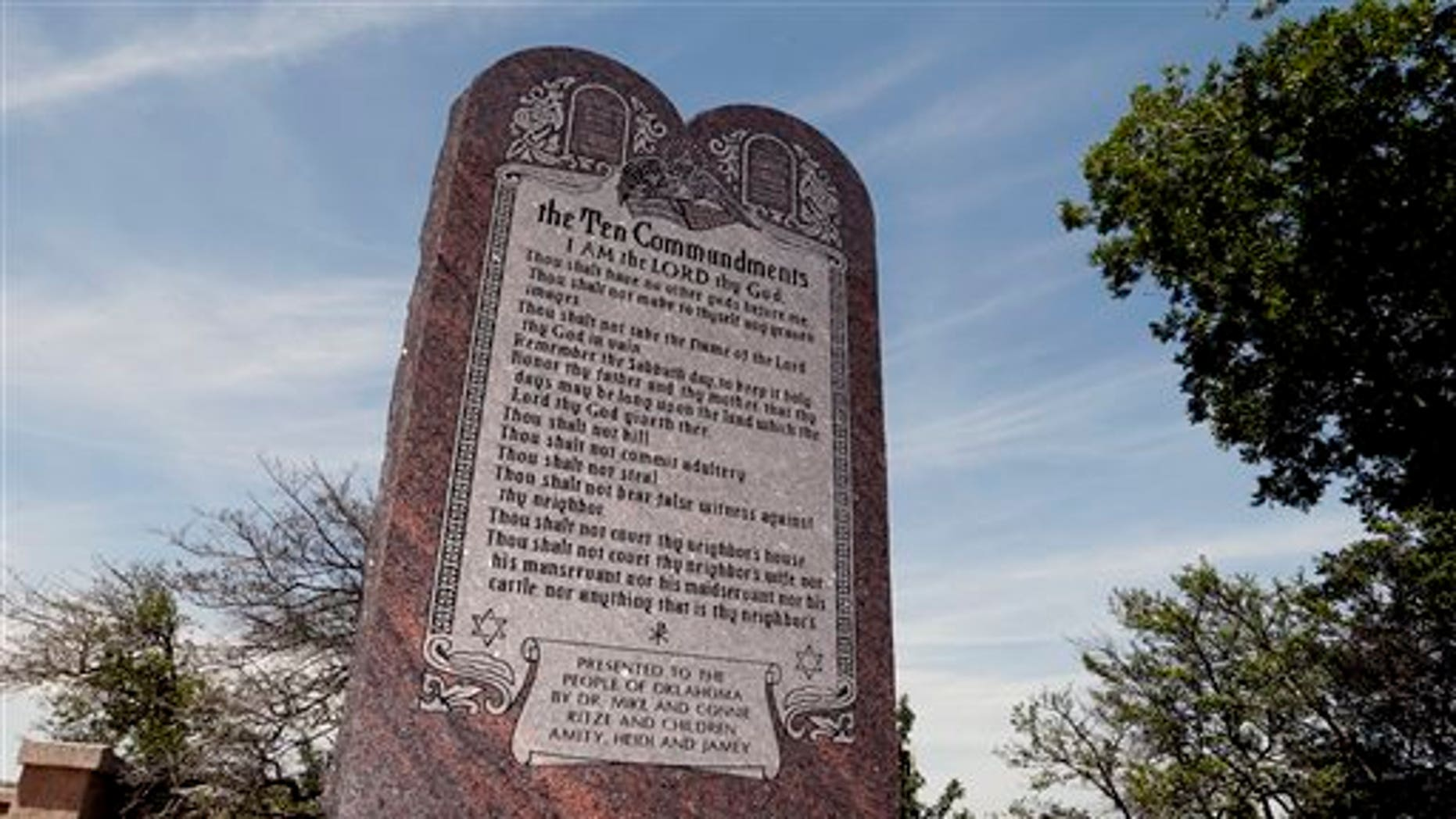 File - This June 20, 2014 file photo is the Ten Commandments monument at the state Capitol in Oklahoma City. The privately funded monument on the grounds of the Oklahoma Capitol does not violate the state constitution and can stay there, an Oklahoma County judge said Friday, Sept. 19, 2014 in a ruling that attorneys who filed the lawsuit in question vowed to appeal to the state Supreme Court. (AP Photo/Sue Ogrocki, File)