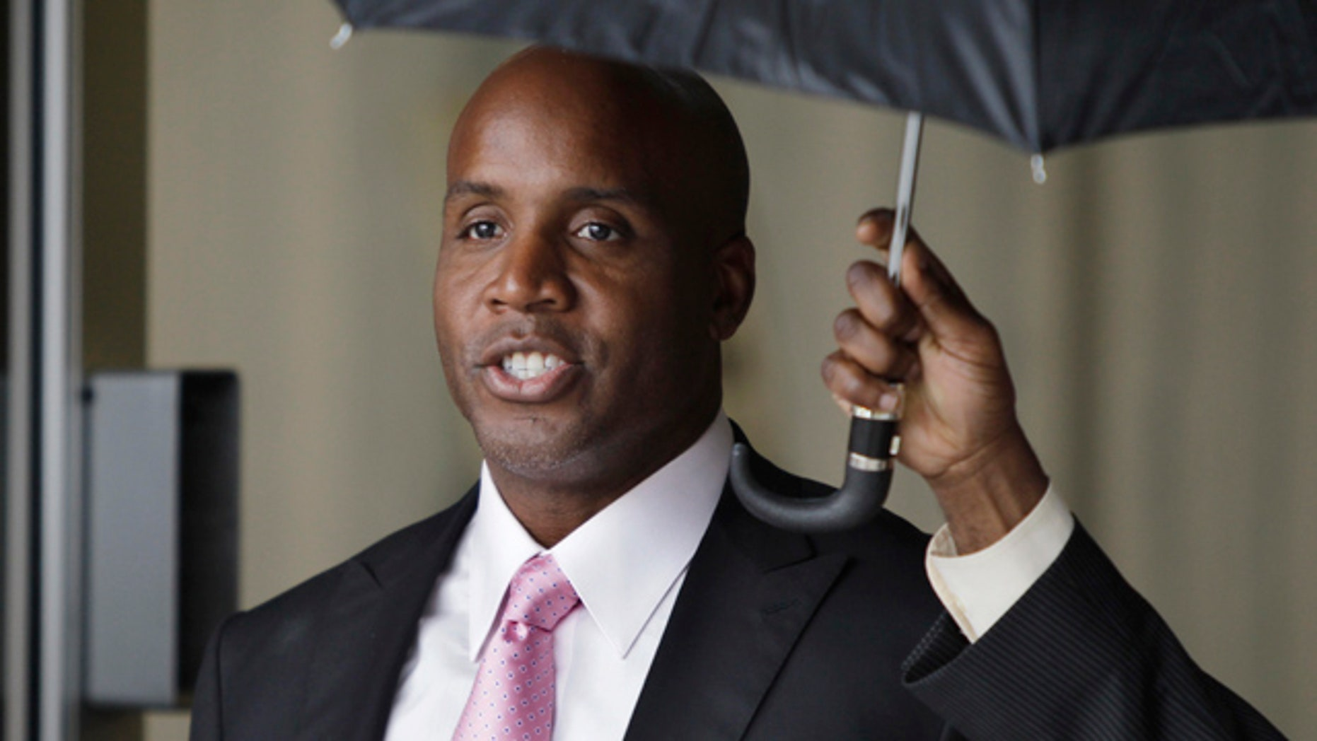 March 24, 2011: Barry Bonds leaves the federal courthouse during his baseball perjury trial in San Francisco.