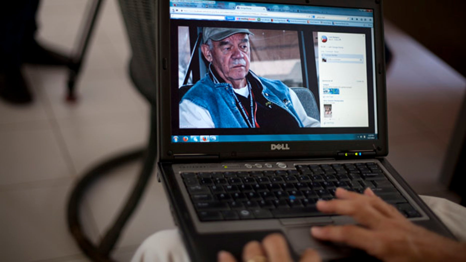May 17, 2014: A picture of George Knoop, 77,  an American missionary who was killed at his home this week, is displayed in a laptop by a member of the mission in Port-au-Prince, Haiti. (AP Photo/Dieu Nalio Chery)