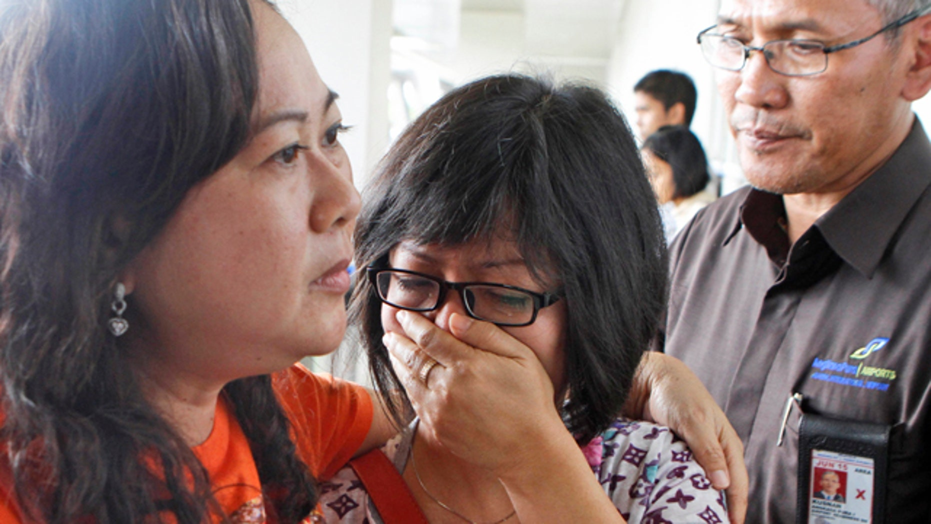 Dec. 28, 2014: A relative of AirAsia flight QZ8501 passengers weeps as she waits for the latest news on the missing jetliner at Juanda International Airport in Surabaya, East Java, Indonesia. (AP Photo/Trisnadi)