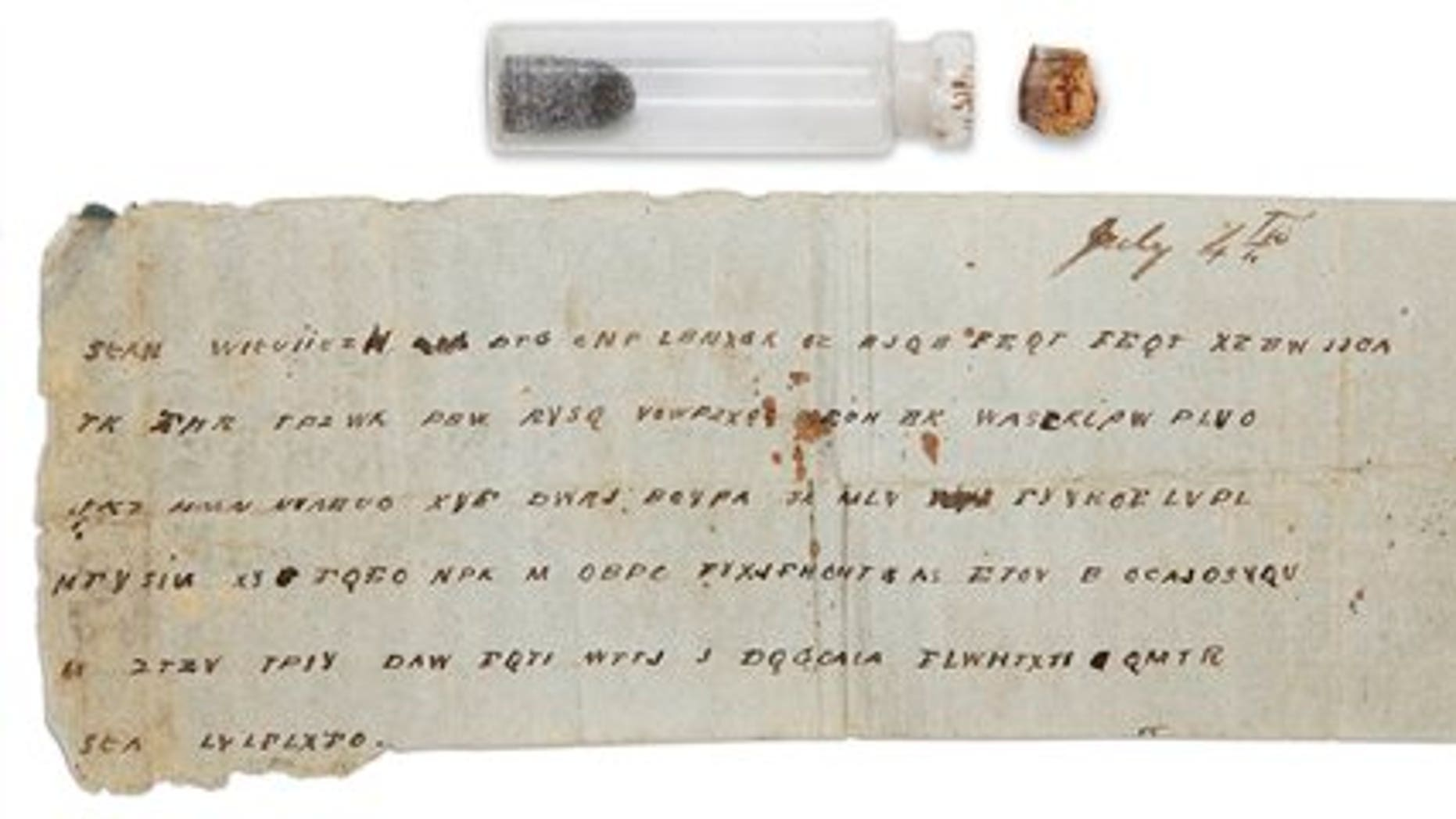 This undated image shows a Civil War-era glass vial and the message that was tucked inside it at the Museum of the Confederacy in Richmond, Va.