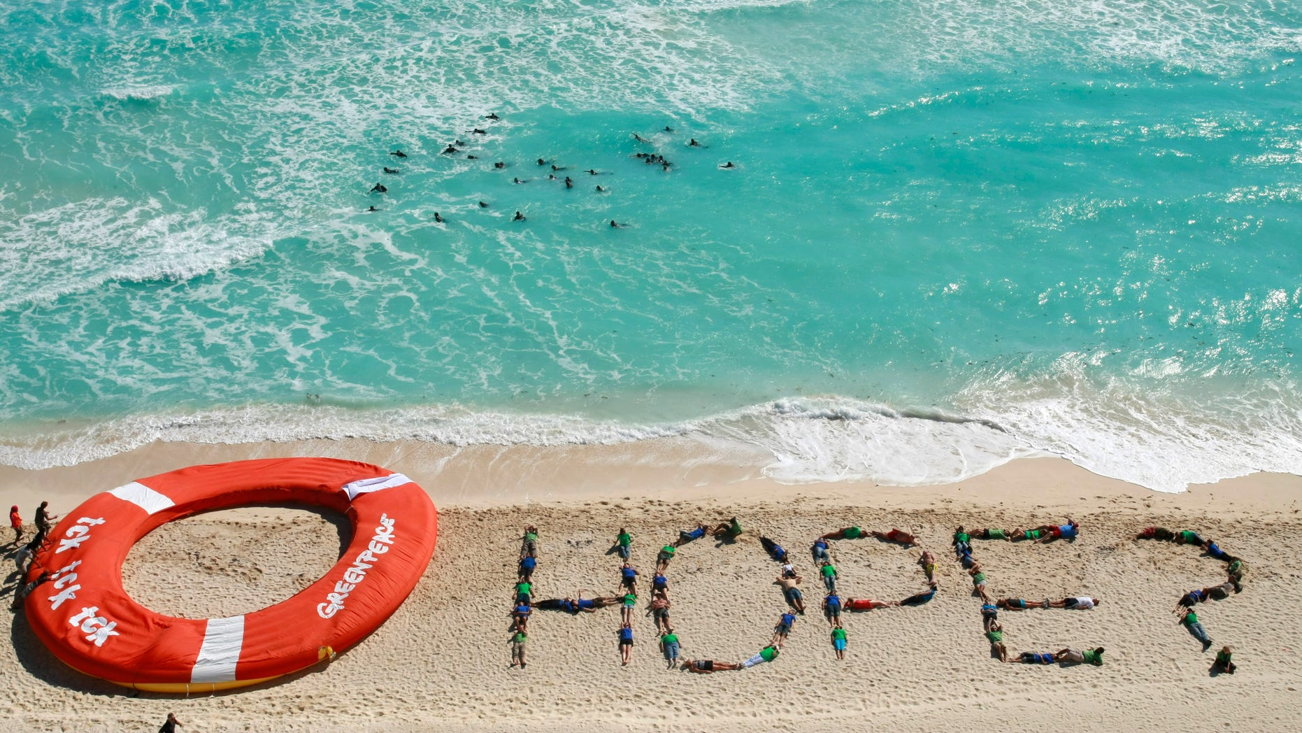 Dec. 10: Greenpeace activists form the word hope as a question with their bodies, next to a giant life saver, during a demonstration near the site of the United Nations Climate Change Conference in Cancun, Mexico.