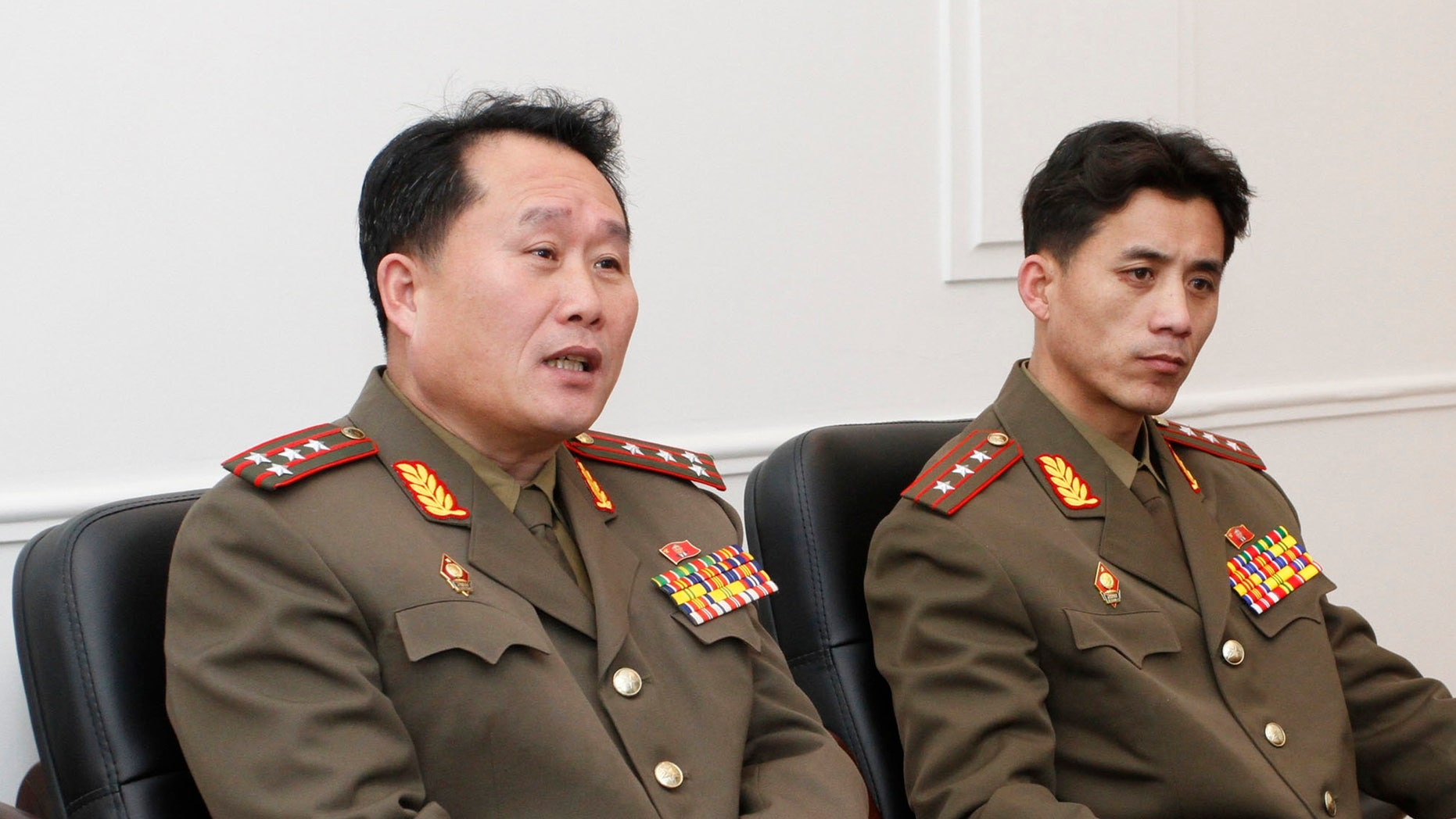 Feb. 2, 2012:  Ri Son Gwon, left, a colonel working for the Policy Department of North Korea's National Defense Commission, accompanied by an unidentified official speaks  in Pyongyang.