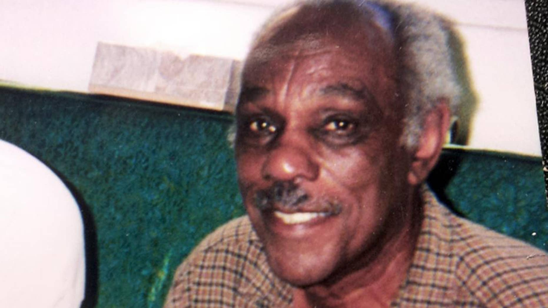 """CORRECTS SPELLING OF LAST NAME TO SHAMBREY - This circa 2000 photo provided by Tim Shambrey shows his father, Joseph Shambrey, a member of the Tuskegee Airmen, the famed all-black squadron that flew in World War II, at his home in Los Angeles. Shambrey and fellow Tuskegee Airman Clarence E. """"Buddy"""" Huntley Jr., lifelong friends who enlisted together, both died on the same day, Monday, Jan. 5, 2015, in their Los Angeles homes, relatives said Sunday, Jan. 11, 2015. Both were 91. Huntley and Shambrey enlisted in 1942 and were shipped overseas to Italy in 1944 with the 100th Fighter Squadron of the Army Air Force's 332nd Fighter Group. As mechanics, they kept the combat planes flying.(AP Photo/Courtesy Tim Shambray)"""