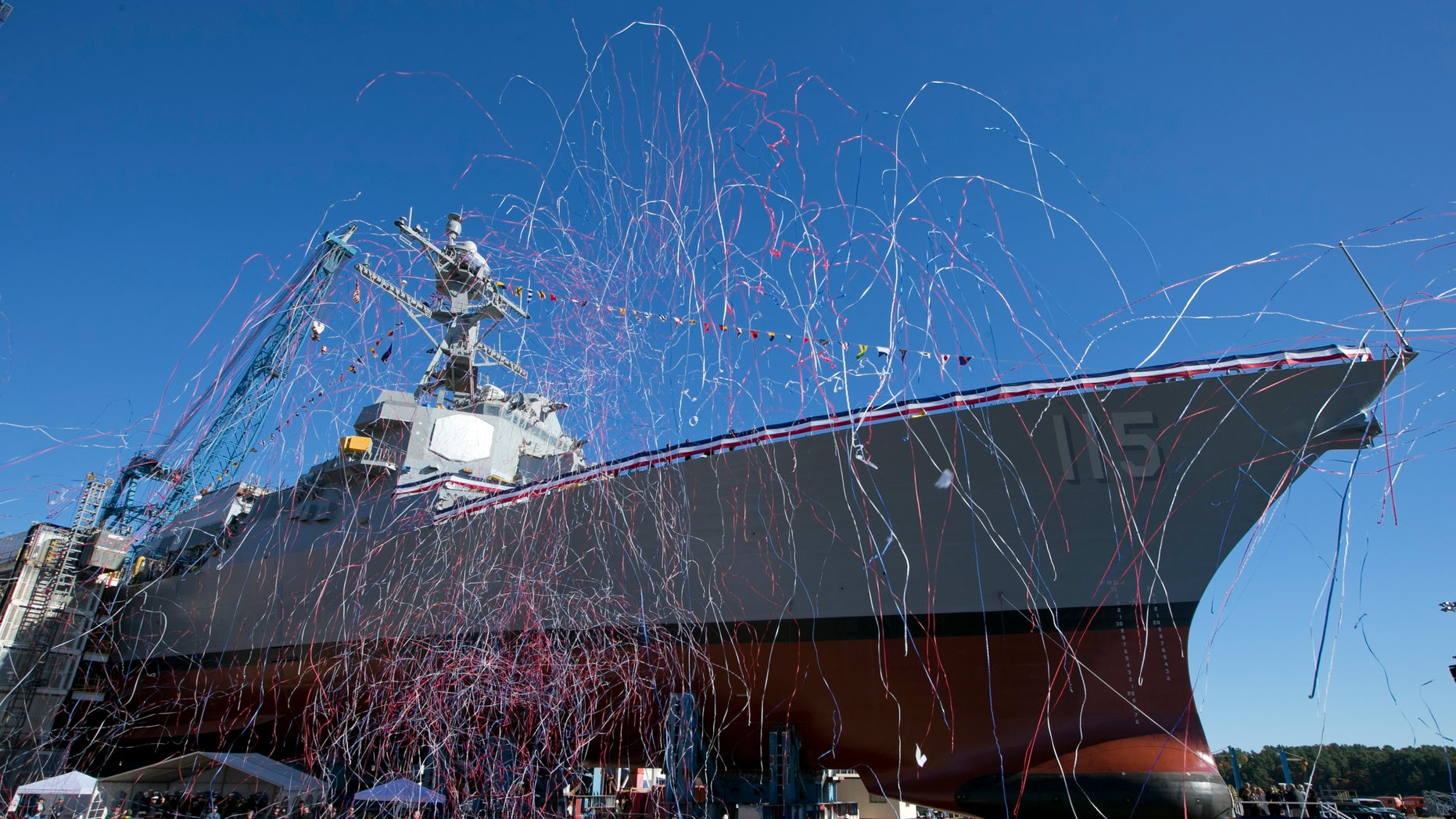 Streamers fly during the christening the USS Rafael Peralta on Saturday, Oct. 31, 2015, in Bath, Maine
