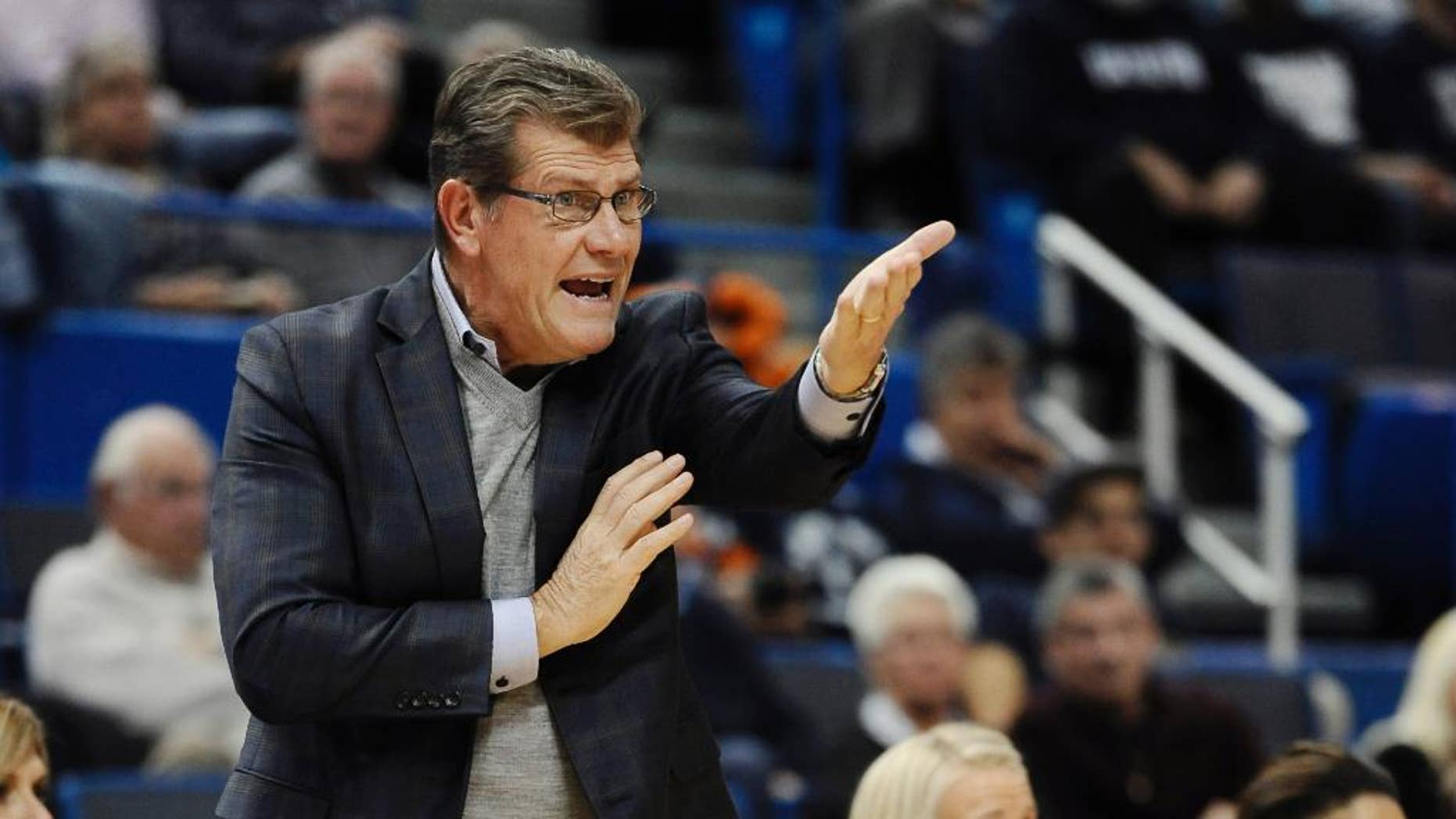 THIS CORRECTS THE NAME OF THE SCHOOL TO POST, NOT C.W. POST AS ORIGINALLY SAENT - Connecticut Geno Auriemma gestures to his team during the first half of an NCAA college basketball game against Post, Sunday, Nov. 9, 2014, in Hartford, Conn. (AP Photo/Jessica Hill)