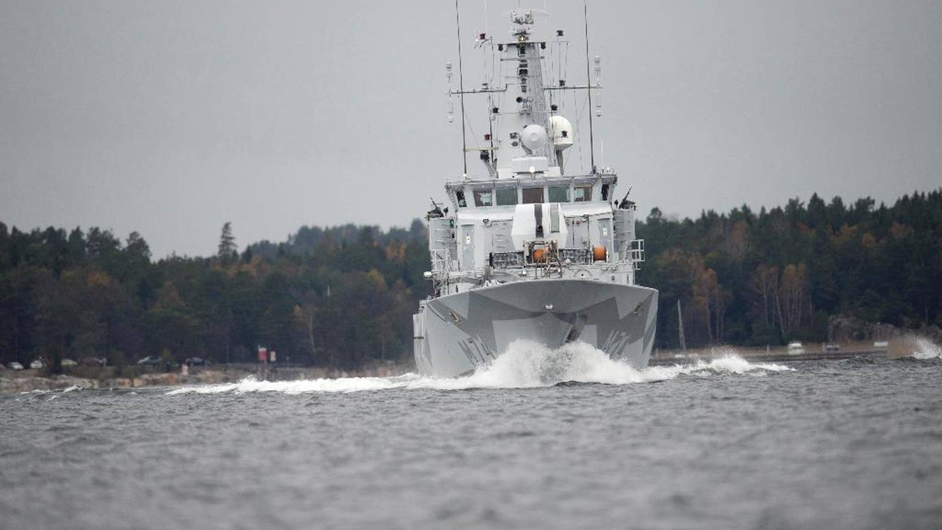 CORRECTS YEAR - The Swedish minesweeper HMS Kullen under way in Namdo Bay, Sweden, Tuesday, Oct. 21, 2014 on their fifth day of searching for a suspected foreign vessel in the Stockholm archipelago. The navy has demanded a 1000-meter, (yard) no-go radius around naval vessels taking part in the current operation. (AP Photo/Fredrik Sandberg)   SWEDEN OUT