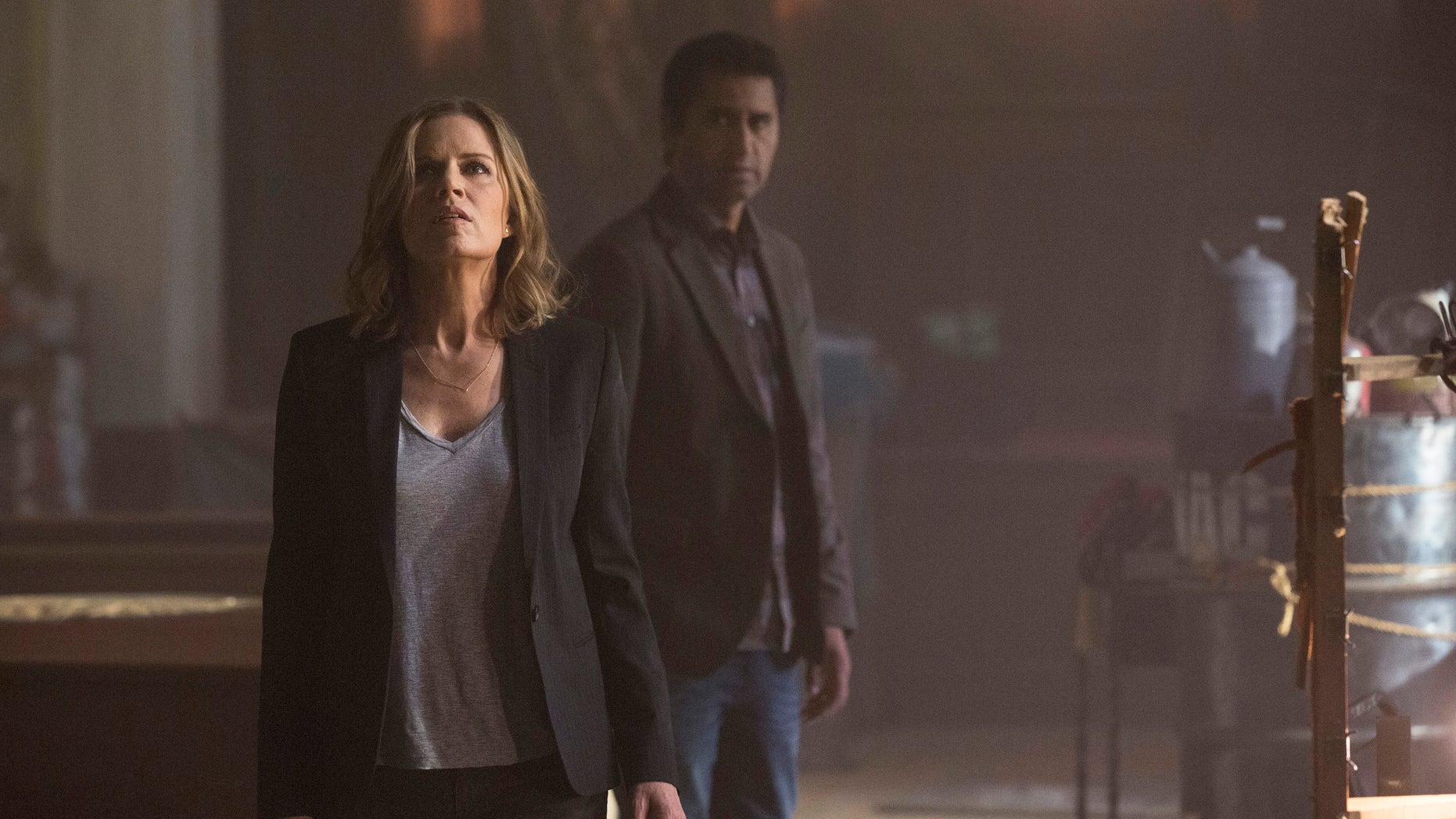 """CORRECTS CHARACTER NAMES, TO MADISON FROM MIRANDA, AND TO TRAVIS FROM SEAN, AND PHOTOGRAPHER TO FRANK OCKENFELS 3, FROM JUSTIN LUBIN  This photo provided by AMC shows, Kim Dickens, left, as Madison and Cliff Curtis as Travis in a scene from """"Fear the Walking Dead,"""" season 1. The series, a spinoff to AMCâs âThe Walking Dead,â debuts 9 p.m. EST Sunday, Aug. 23, 2015. (Frank Ockenfels 3/AMC via AP)"""