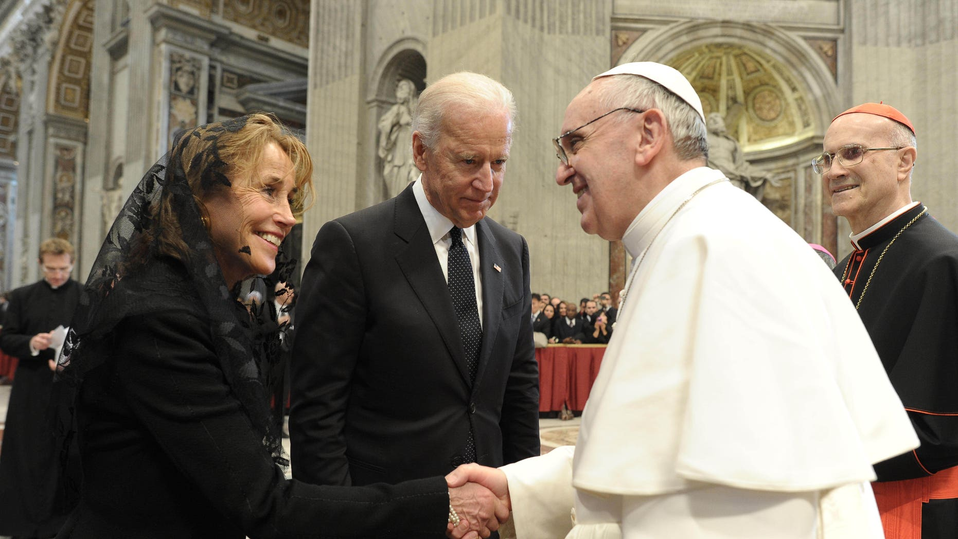 In this photo provided by the Vatican paper L'Osservatore Romano, Pope Francis meets U.S. Vice President Joe Biden and his sister, Valerie Biden Owens, after his installation Mass at the Vatican on Tuesday, March 19, 2013. Pope Francis has urged princes, presidents, sheikhs and thousands of ordinary people gathered for his installation Mass to protect God's creation, the weakest and the poorest of the world. (AP Photo/L'Osservatore Romano)