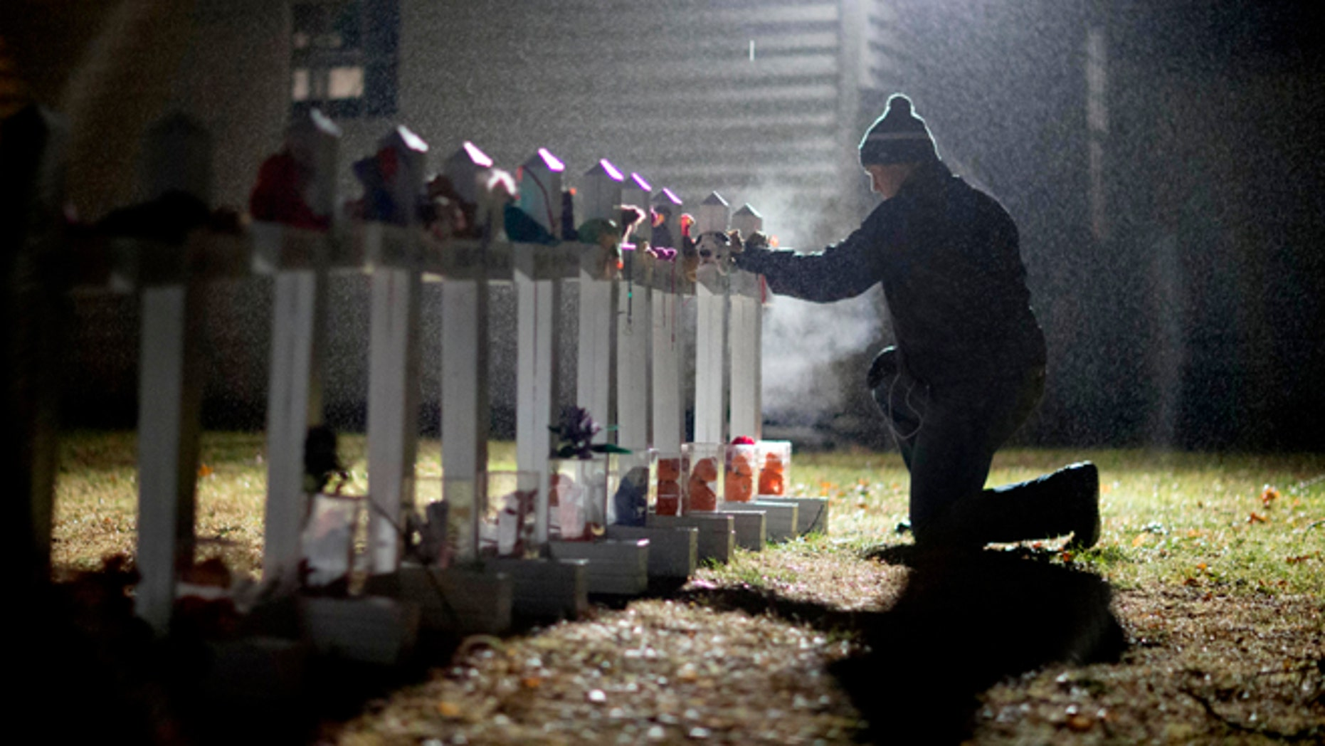 A display of wooden crosses and a Star of David for the Sandy Hook victims, in 2012.