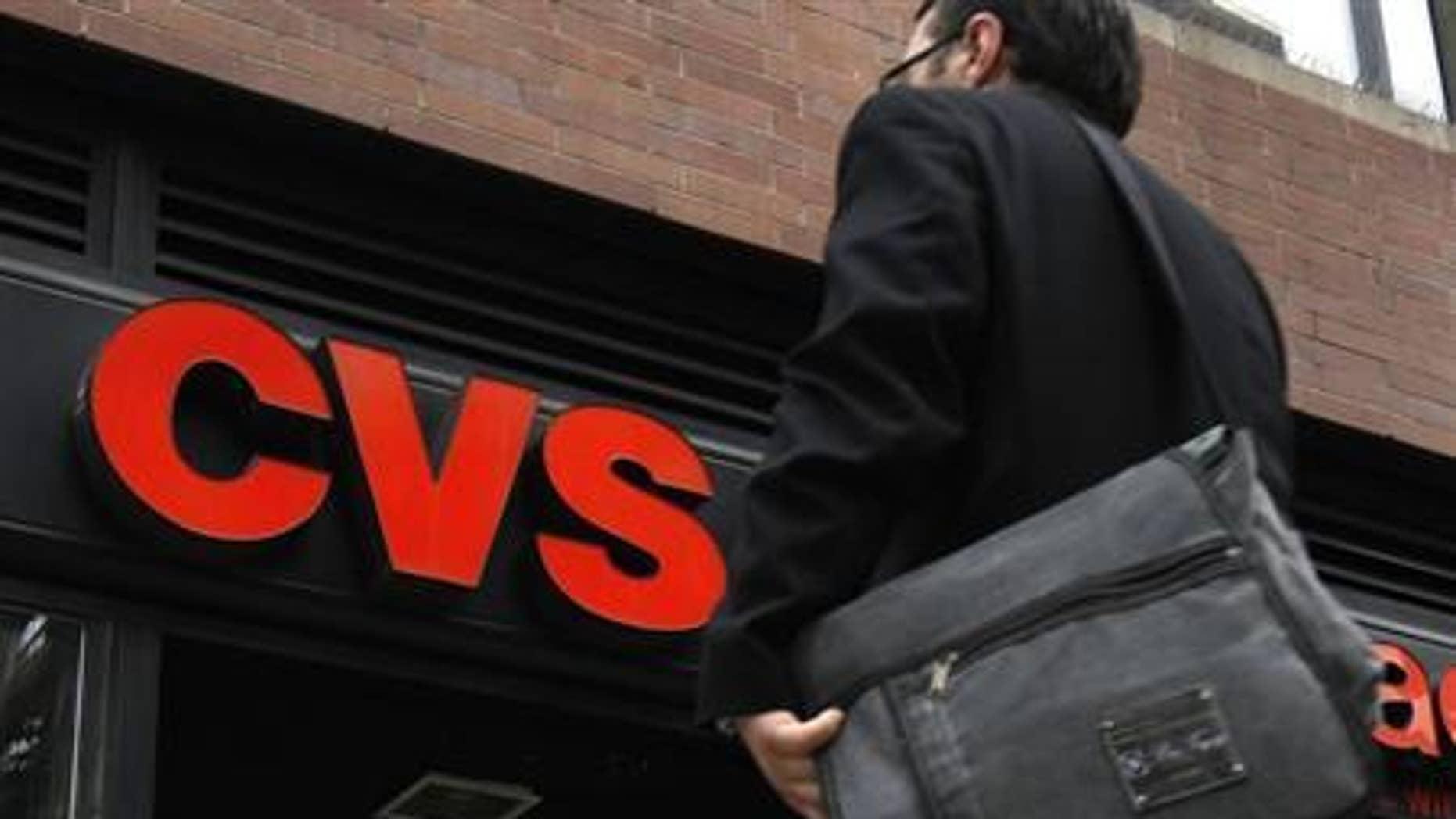A man walks outside CVS pharmacy in New York City July 28, 2010. REUTERS/Mike Segar