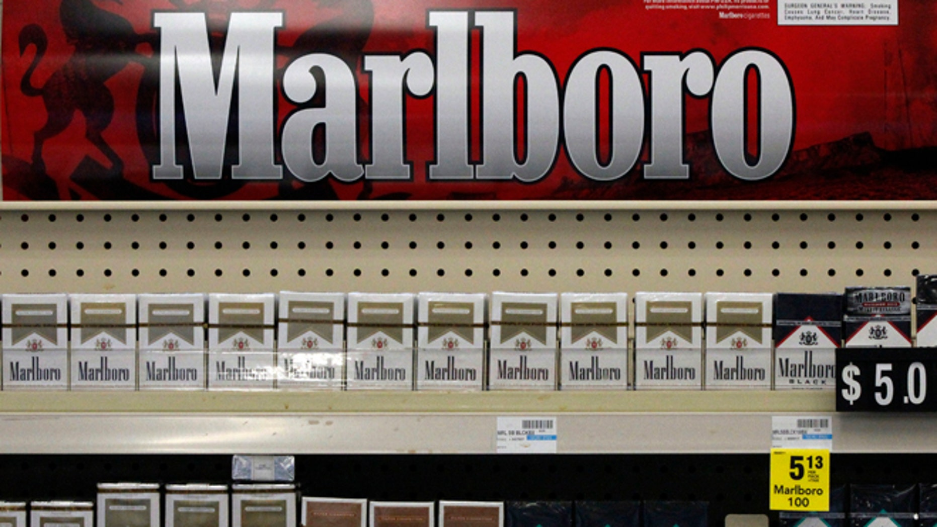 FILE - In this Wednesday, July 17, 2013 file photo, Marlboro cigarettes are on display in a CVS store in Pittsburgh. The nation's second-largest drugstore chain says it will phase out cigarettes, cigars and chewing tobacco by Oct. 1 as it continues to focus more on health care. The move will cost the Woonsocket, R.I., company about $2 billion in annual revenue. (AP Photo/Gene J. Puskar, File)