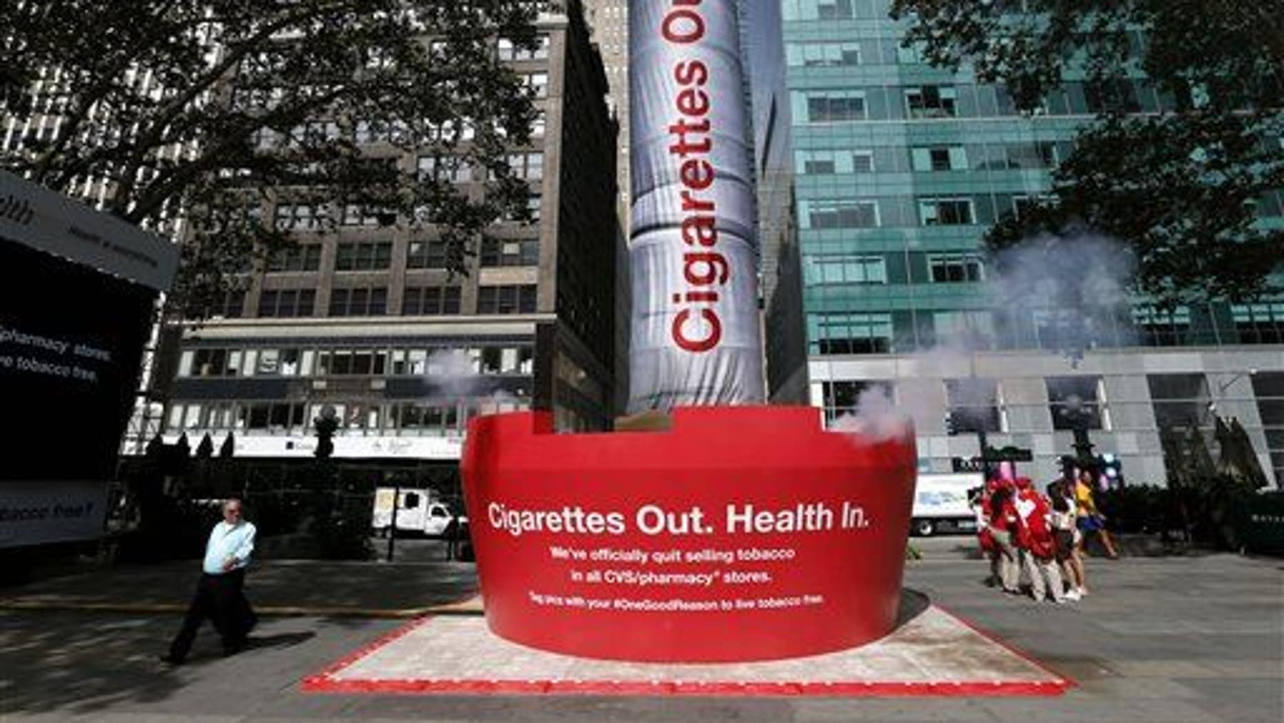 An inflatable cigarette is displayed to announce the CVS decision to stop selling cigarettes at its stores last fall.