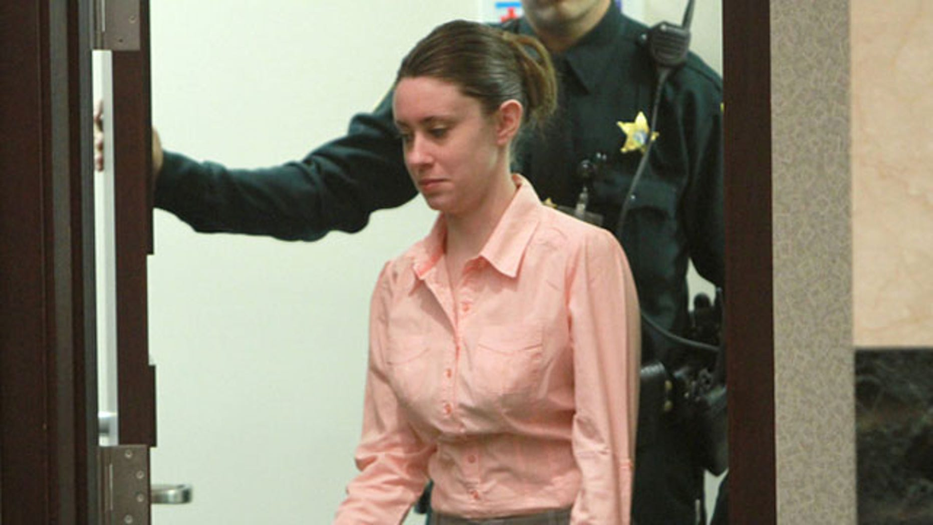 June 8: Casey Anthony walks into the Orlando court to hear testimony from a forensic computer expert.