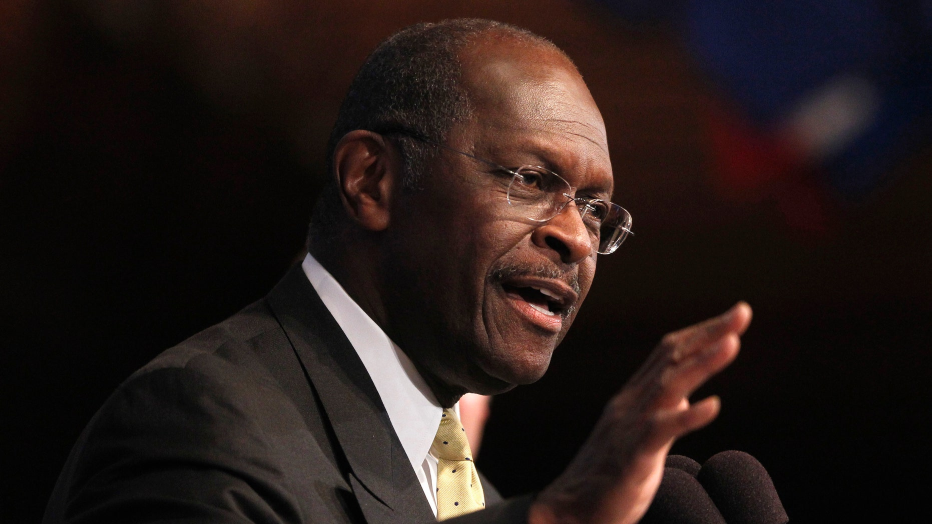 Republican presidential candidate, Herman Cain sings for members of the audience at the National Press Club in Washington, Monday, Oct. 31, 2011. (AP Photo/Pablo Martinez Monsivais)