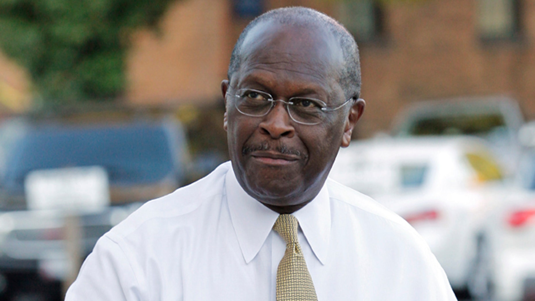 Oct. 16,  2011: Herman Cain arrives for a Sunday talk show interview.
