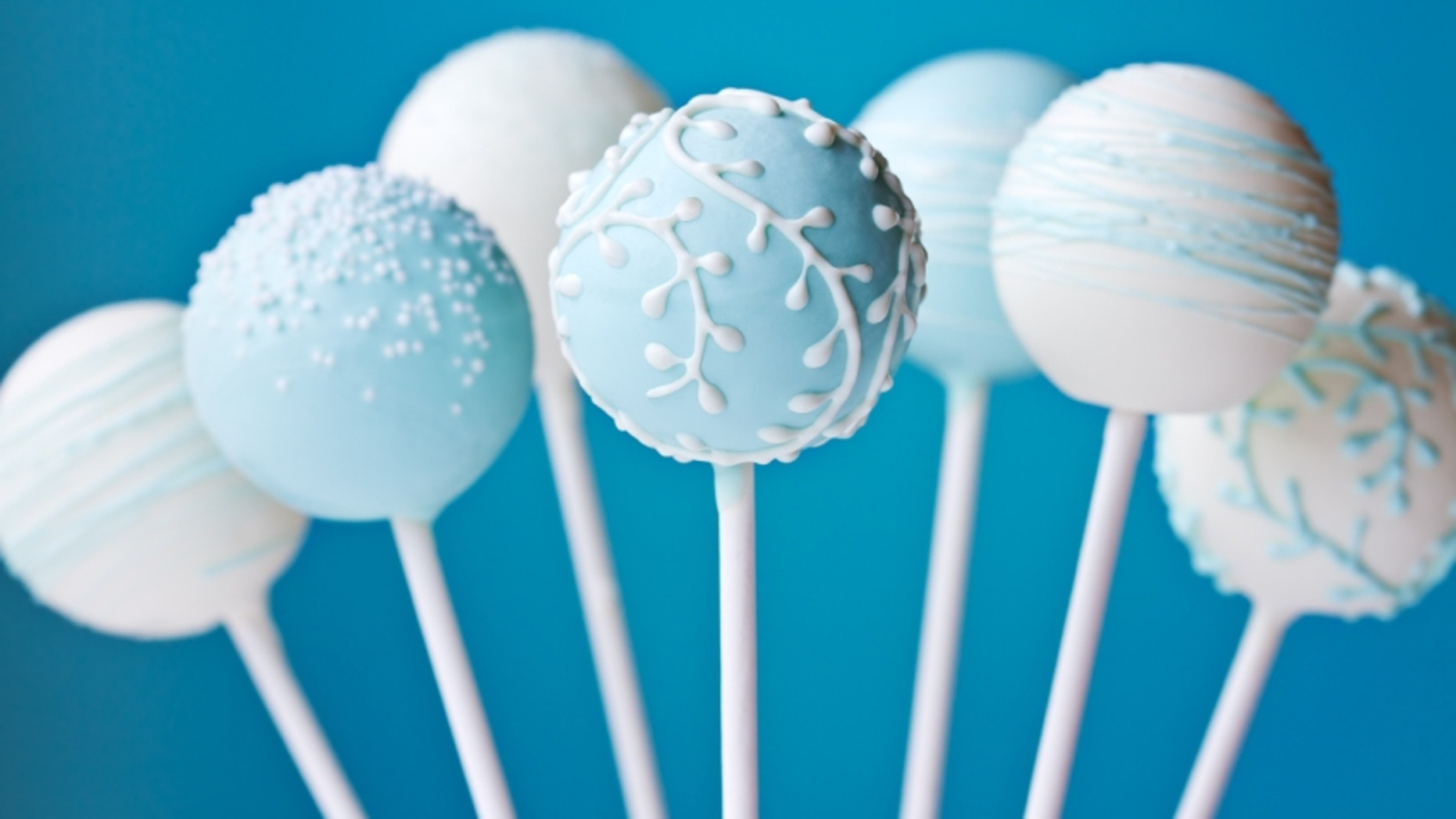 Cake pops decorated in blue and white
