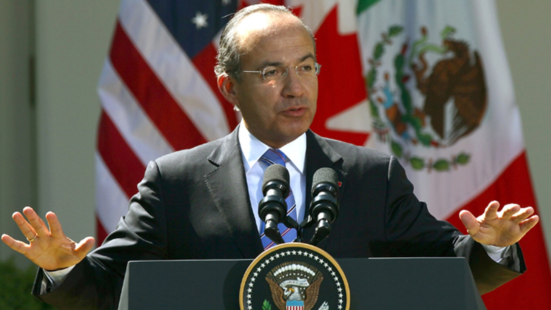 WASHINGTON, DC - APRIL 02:  Mexican President Felipe Calderon answers a question during a joint press conference with U.S. President Barack Obama and Canadian Prime Minister Stephen Harper in the Rose Garden of the White House April 2, 2012 in Washington, DC. Obama hosted his counterparts from Canada and Mexico for the North American Leaders' Summit (NALS) with talks on cooperation among the three countries.  (Photo by Win McNamee/Getty Images)