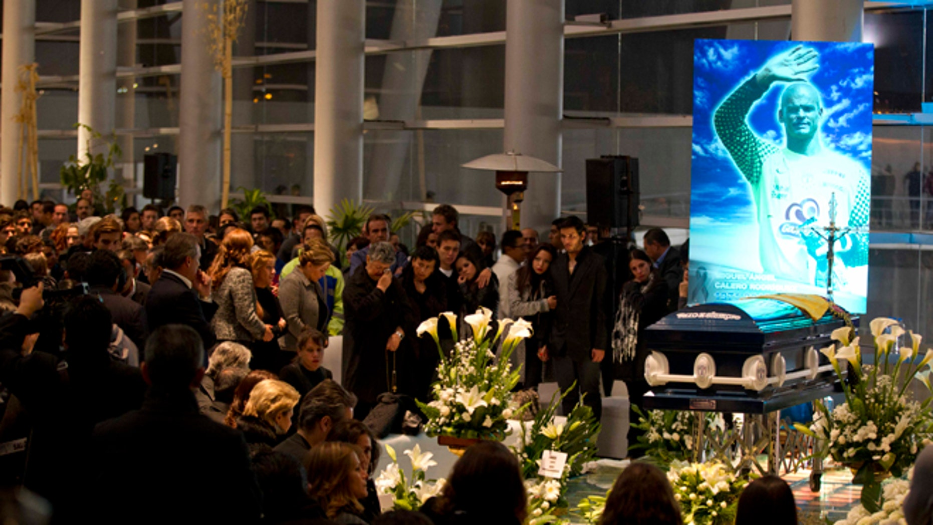 People attend the wake of Colombia's former goalkeeper Miguel Calero in Pachuca, Mexico, Tuesday, Dec. 4, 2012. Calero died on Tuesday after suffering a stroke on Nov. 25. (AP Photo/Eduardo Verdugo)