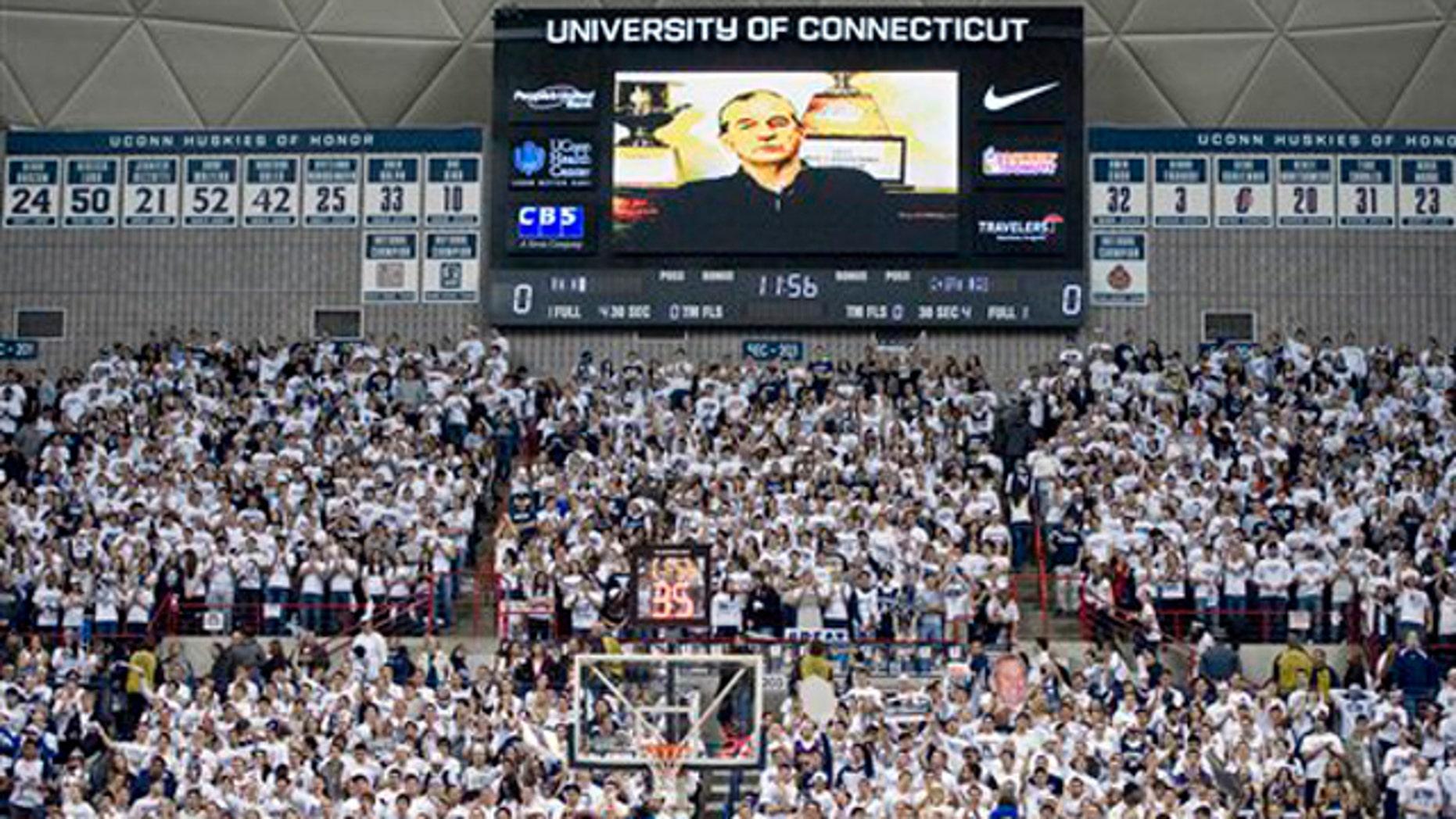 Feb. 25, 2012: Connecticut head coach Jim Calhoun addresses fans prior to an NCAA college basketball game against Syracuse in Storrs, Conn.