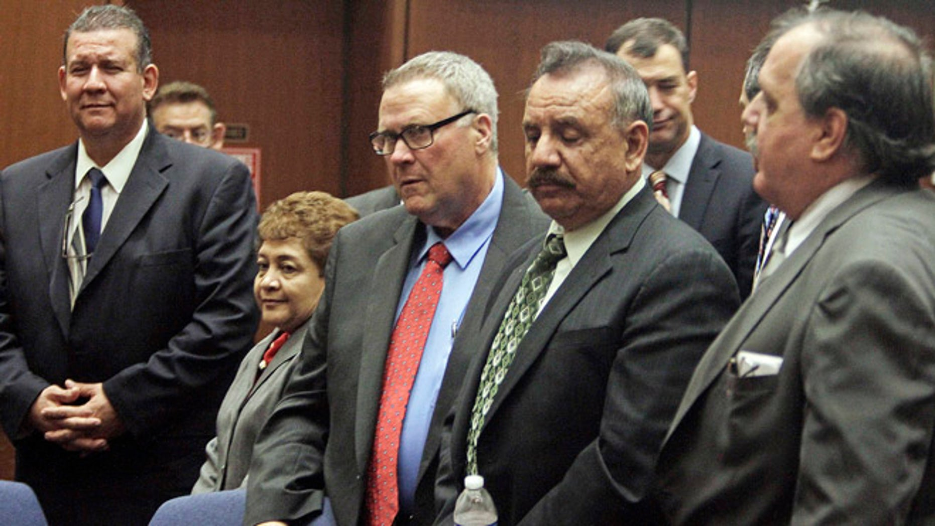 Jan. 24, 2013: In this file photo,  former Bell, Calif., city officials appear for a massive city corruption trial in a downtown Los Angeles courtroom.