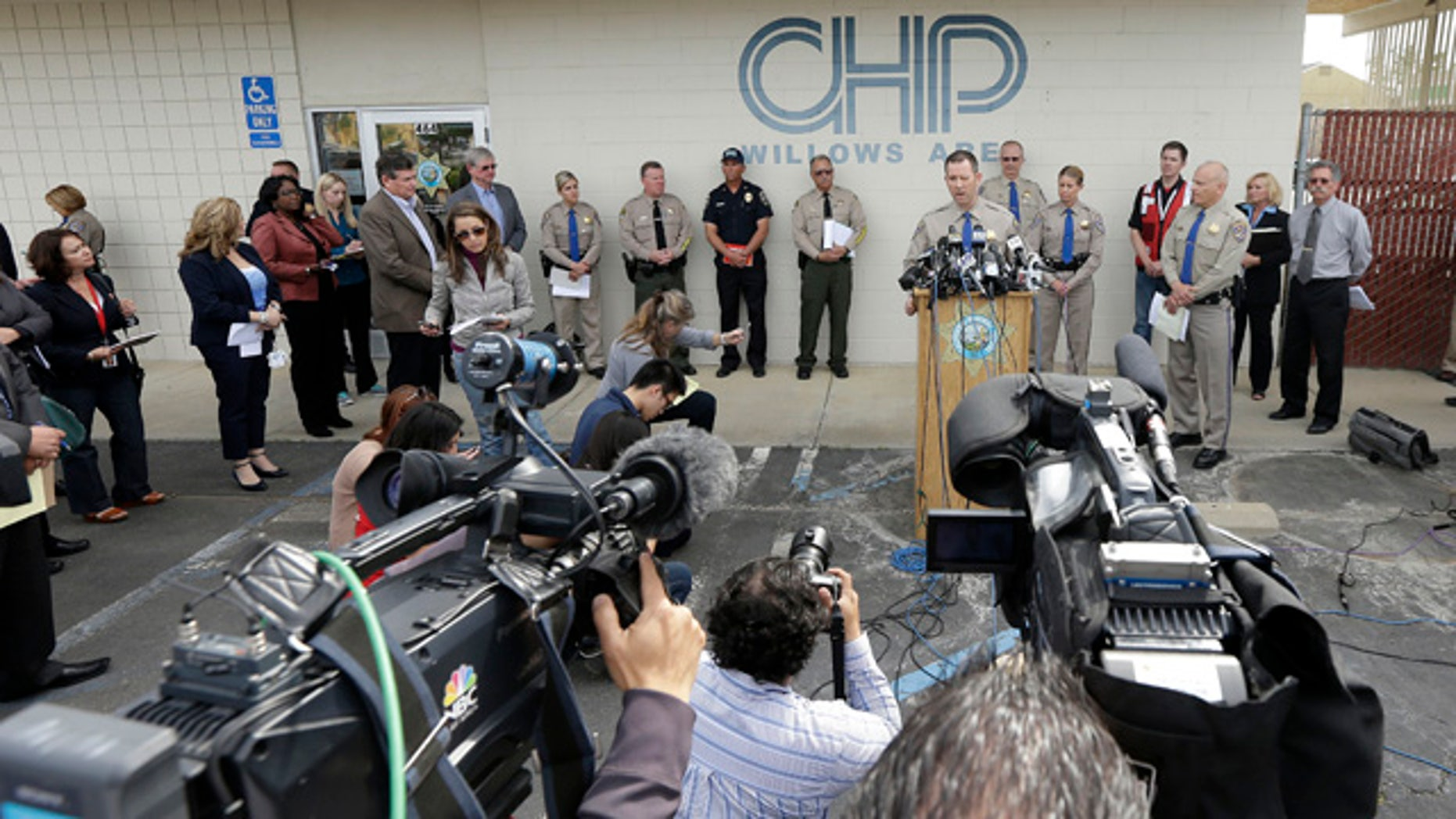 April 11, 2014: California Highway Patrol Multidisciplinary Accident Investigation Team Lt. Scott Fredrick, center right, speaks at a news conference in Willows, Calif. At least ten people were killed and dozens injured in the fiery crash between a FedEx truck and a bus carrying high school students on a visit to a Northern California College. (AP Photo/Jeff Chiu)