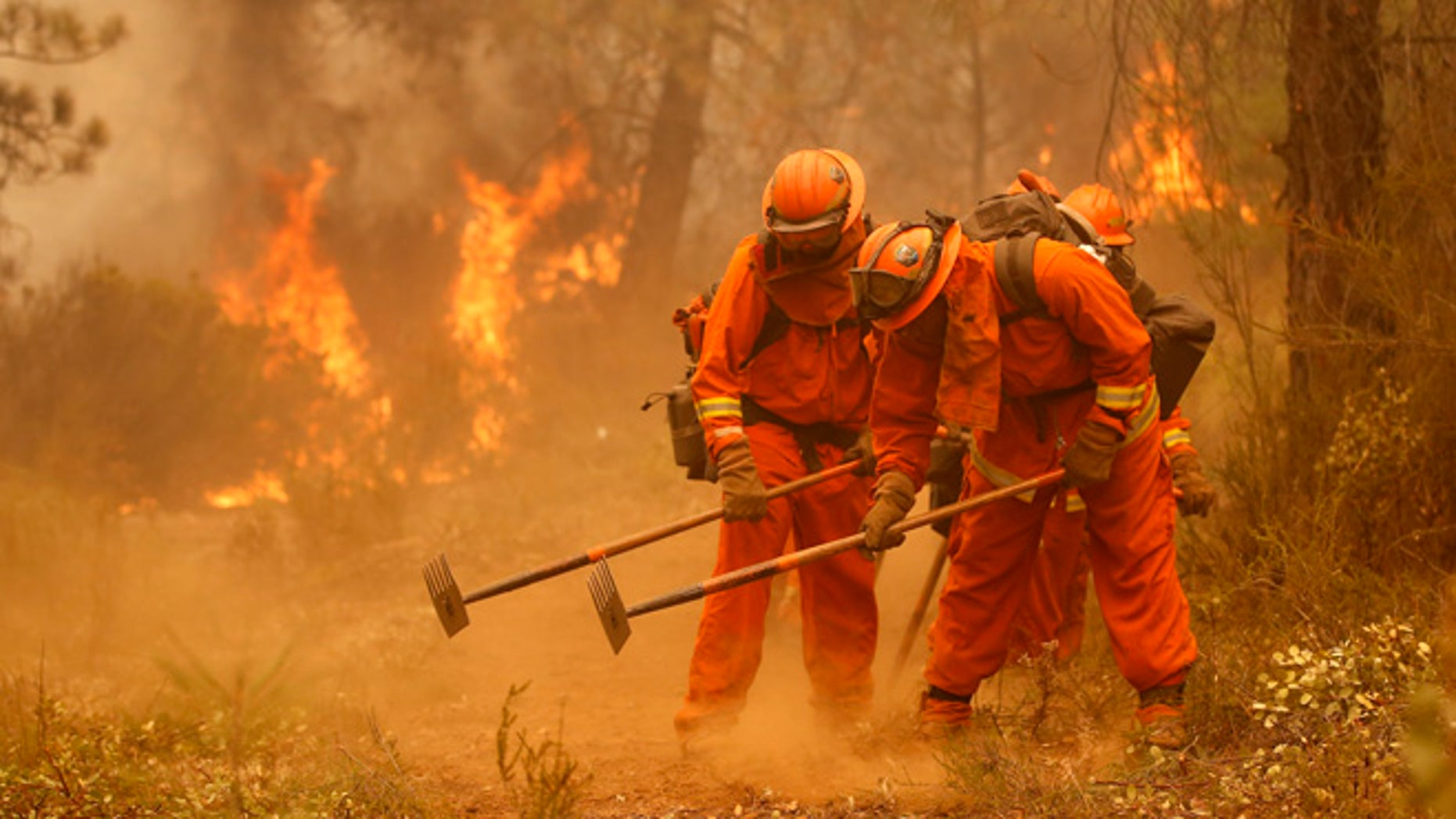 Sept. 12, 2015: A California Department of Corrections and Rehabilitation inmate work crew builds a containment line ahead of flames from a fire.