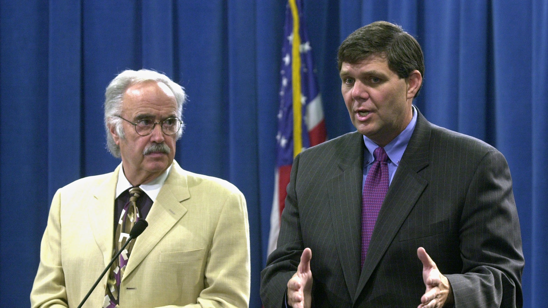 In this July 24, 2003 file photo, then State Sen. Minority Leader Jim Brutle, right, speaks next to then Senate President Pro tem John Burton, D-San Francisco, left, during a Capitol news conference in Sacramento, Calif.