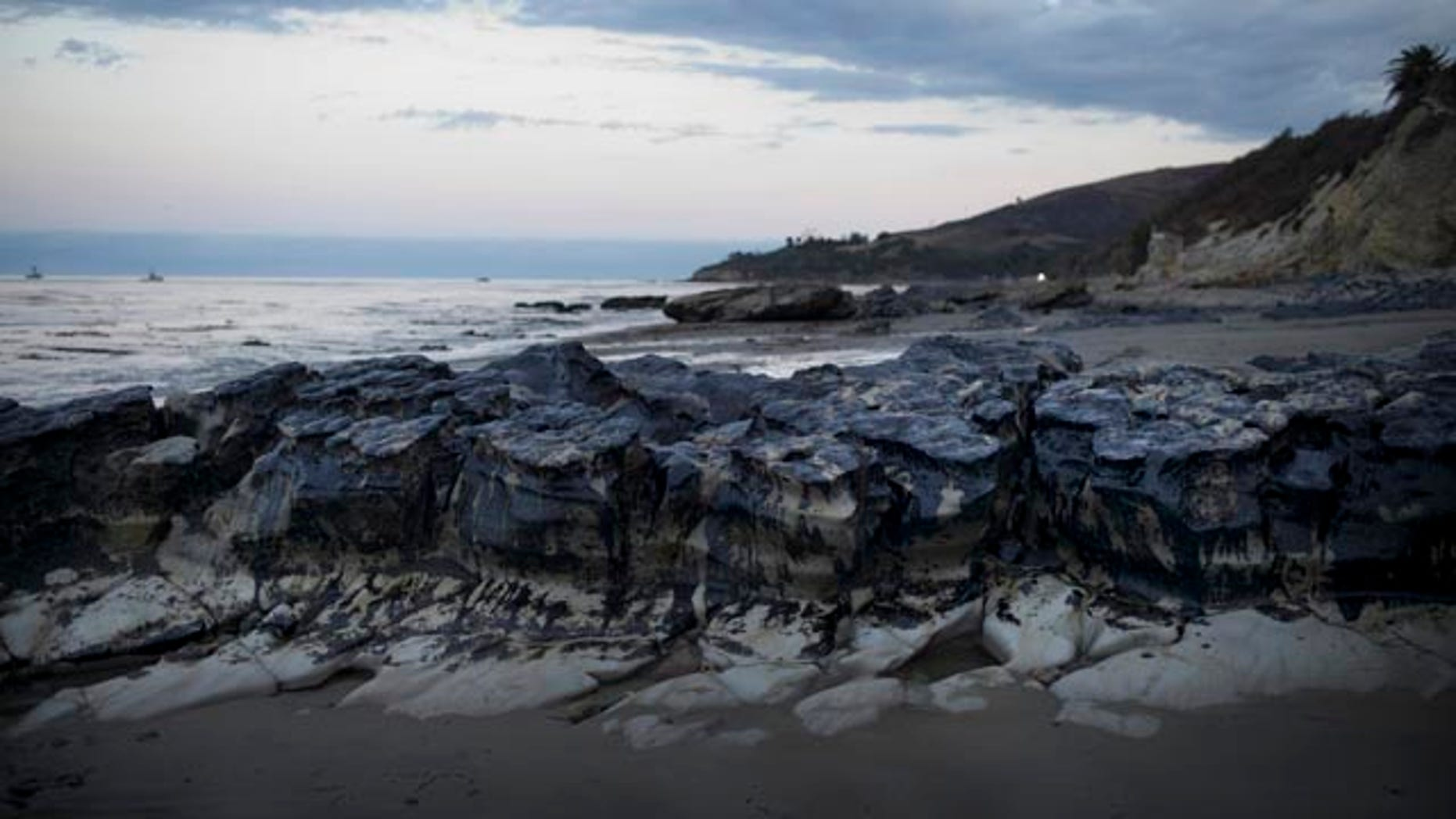 May 21, 2015: Rocks are covered with oil on the beach at Refugio State Beach, north of Goleta, Calif. (AP Photo/Jae C. Hong)