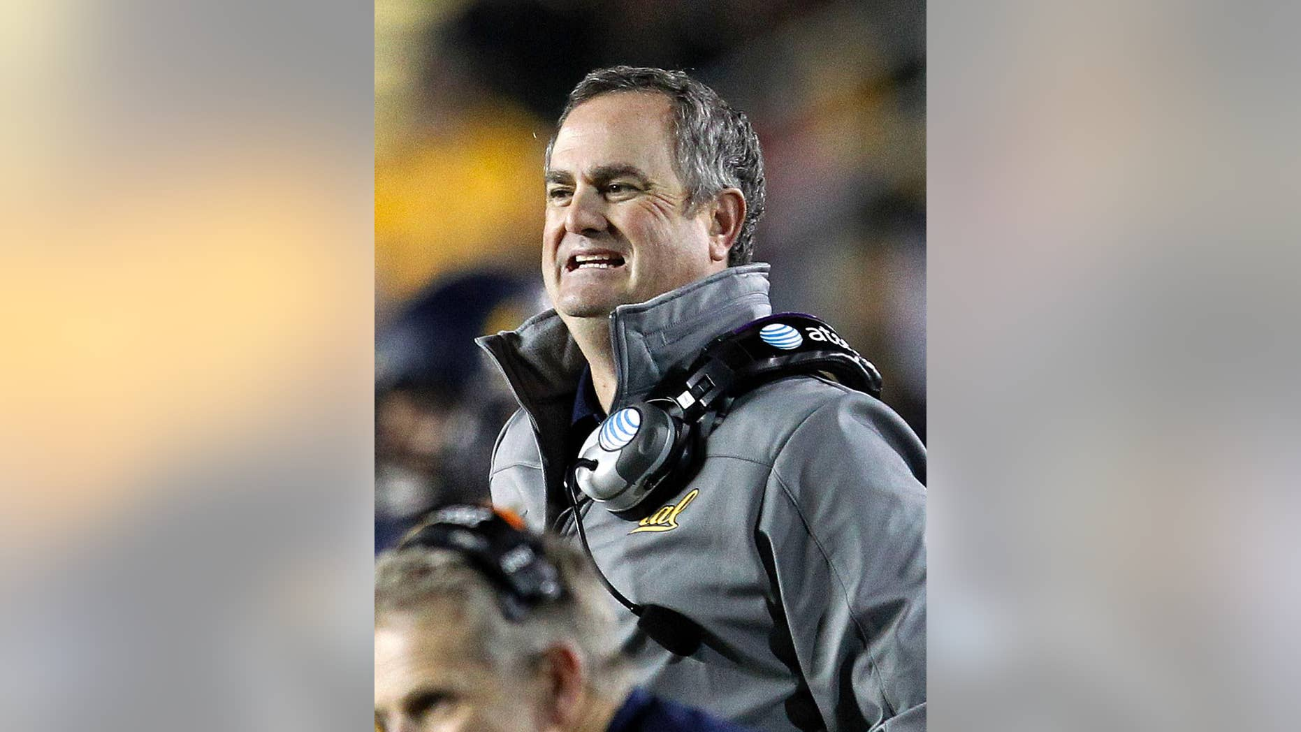 FILE - In this Oct. 19, 2013, file photo, California head coach Sonny Dykes reacts on the sidelines against Oregon State during an NCAA college football game in Berkeley, Calif. The difference in attitude at California is stark heading into coach Dykes' second season. The players are excited about practice, focused on football and eager to put last season's disappointing one-win campaign far in the past. (AP Photo/Tony Avelar,File)