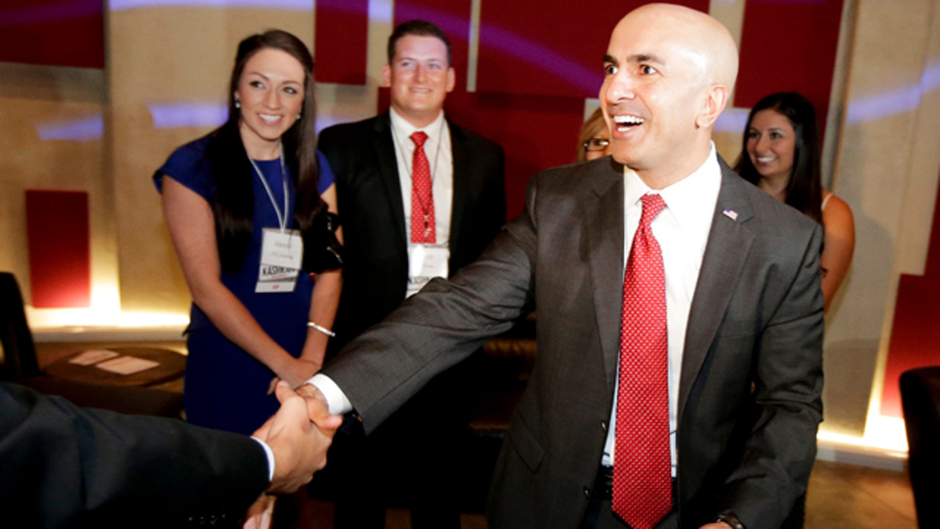 June 3, 2014: California Republican Gubernatorial Candidate Neel Kashkari greets supporters during an election night party at the Port Theater in the Corona Del Mar area of Newport Beach, Calif. Two Republicans are vying for the chance to challenge Gov. Jerry Brown in November. (AP Photo/Chris Carlson)