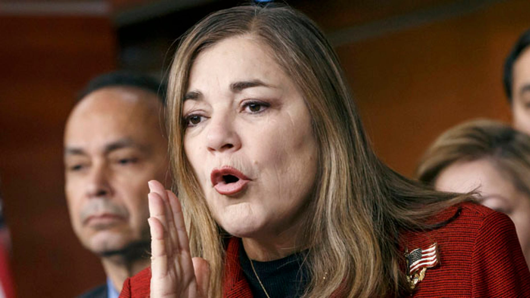 FILE - In this Feb. 13, 2015 file photo, Rep. Loretta Sanchez, D-Calif., responds to questions at a news conference on Capitol Hill in Washington. California Attorney General Kamala Harris would love to oust her strongest rival, fellow Democrat Sanchez, in the primary for California's open U.S. Senate seat, but it's more likely the two will face off again in November. With time running short before the June 7 primary, it appears the two Democrats will be the top vote-getters, presenting a reminder of the waning influence of Republicans in the nation's most populous state. (AP Photo/J. Scott Applewhite, File)